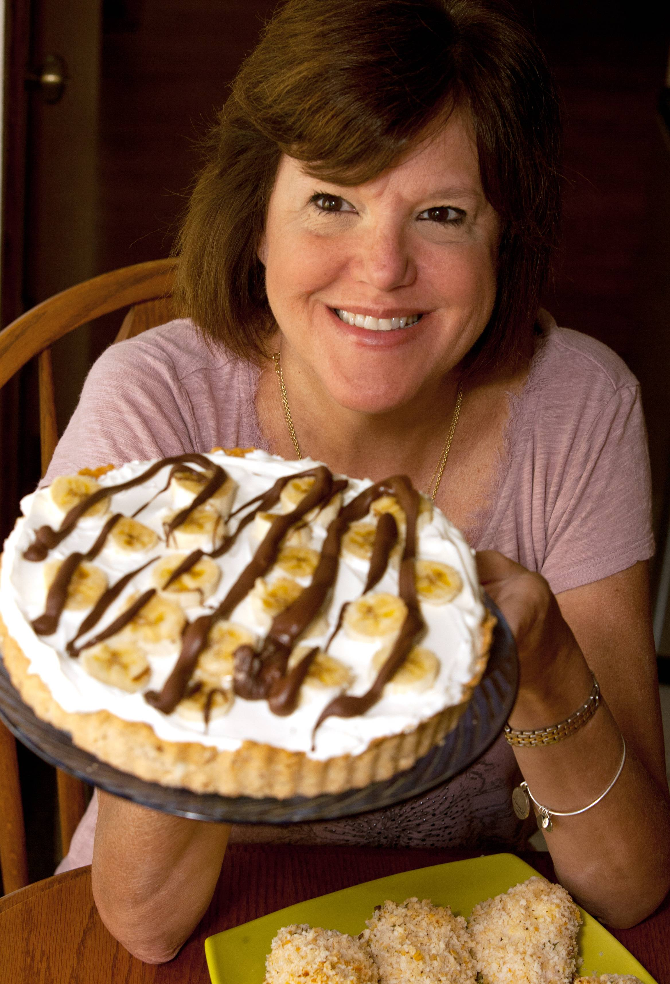 Making guests happy keeps Penny Kadlec of Wood Dale cooking. When Banana Caramel Pie is on her table they can't help but smile.