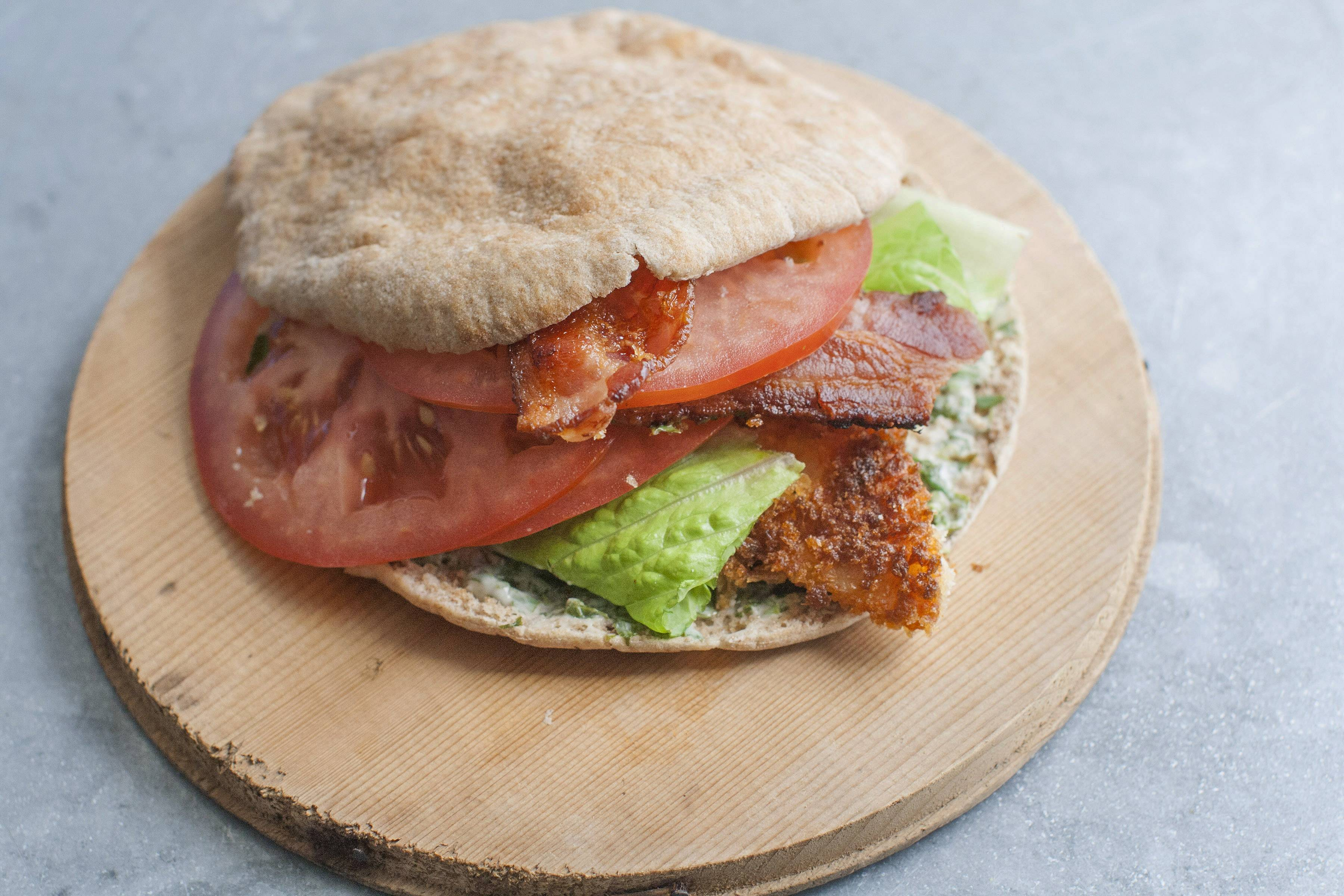 Lightly breaded tilapia boosts the flavor of a BLT without much added fat.