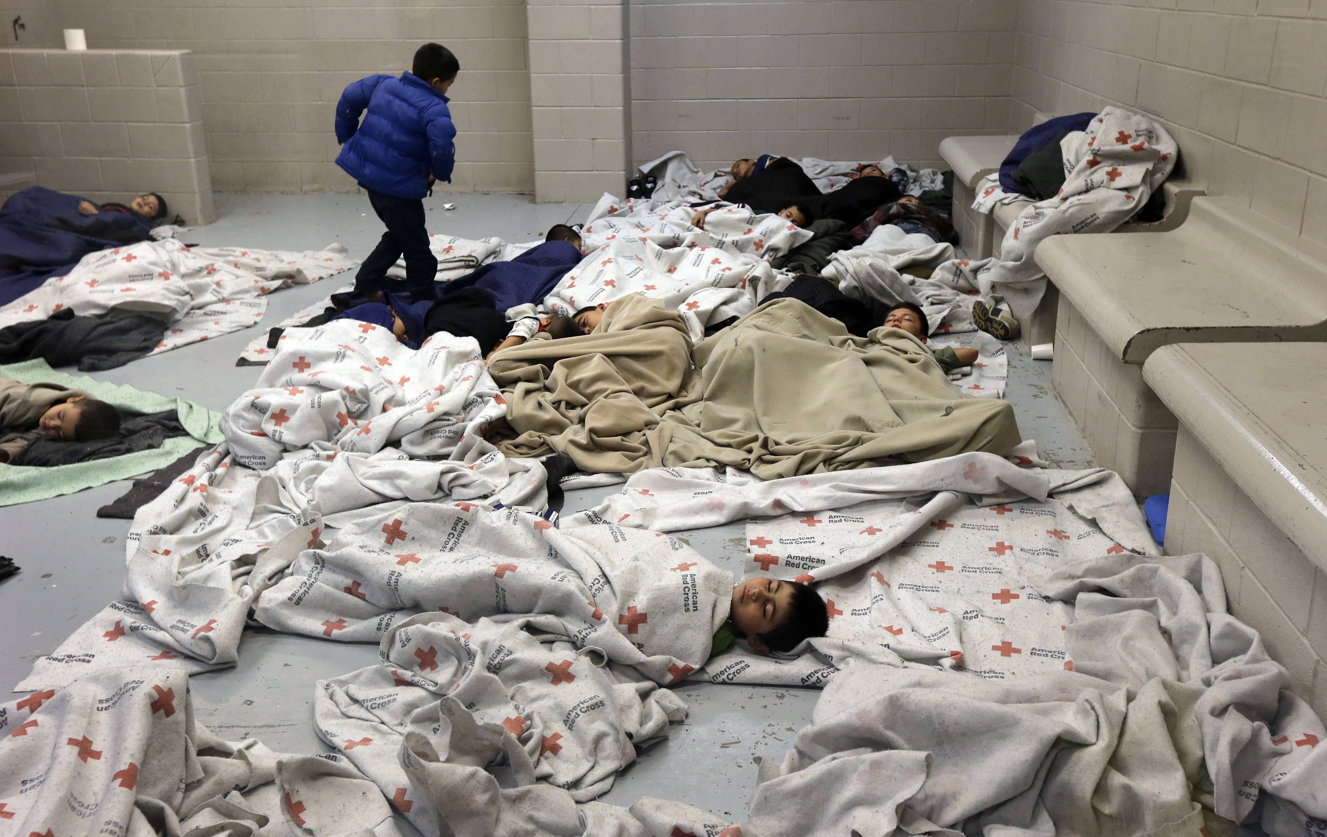 Detainees sleep in a holding cell at a U.S. Customs and Border Protection processing facility in Brownsville,Texas. For nearly two months, images of immigrant children who have crossed the border without a parent, only to wind up in concrete holding cells once in United States, have tugged at heartstrings. Yet most Americans now say U.S. law should be changed so they can be sent home quickly, without a deportation hearing.