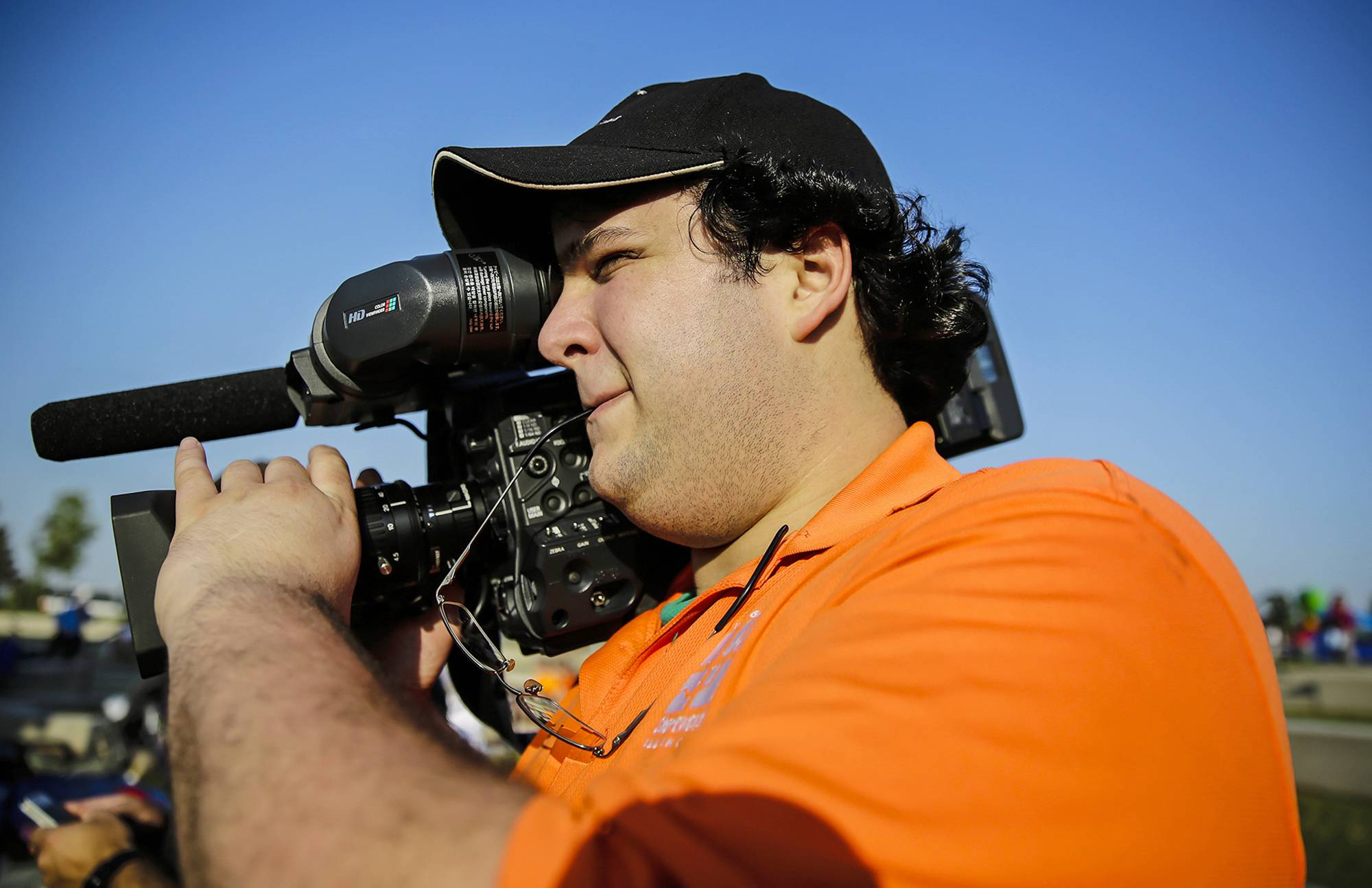 Conlan Fay films before an outdoor movie event at Towne Center Park in Shorewood.