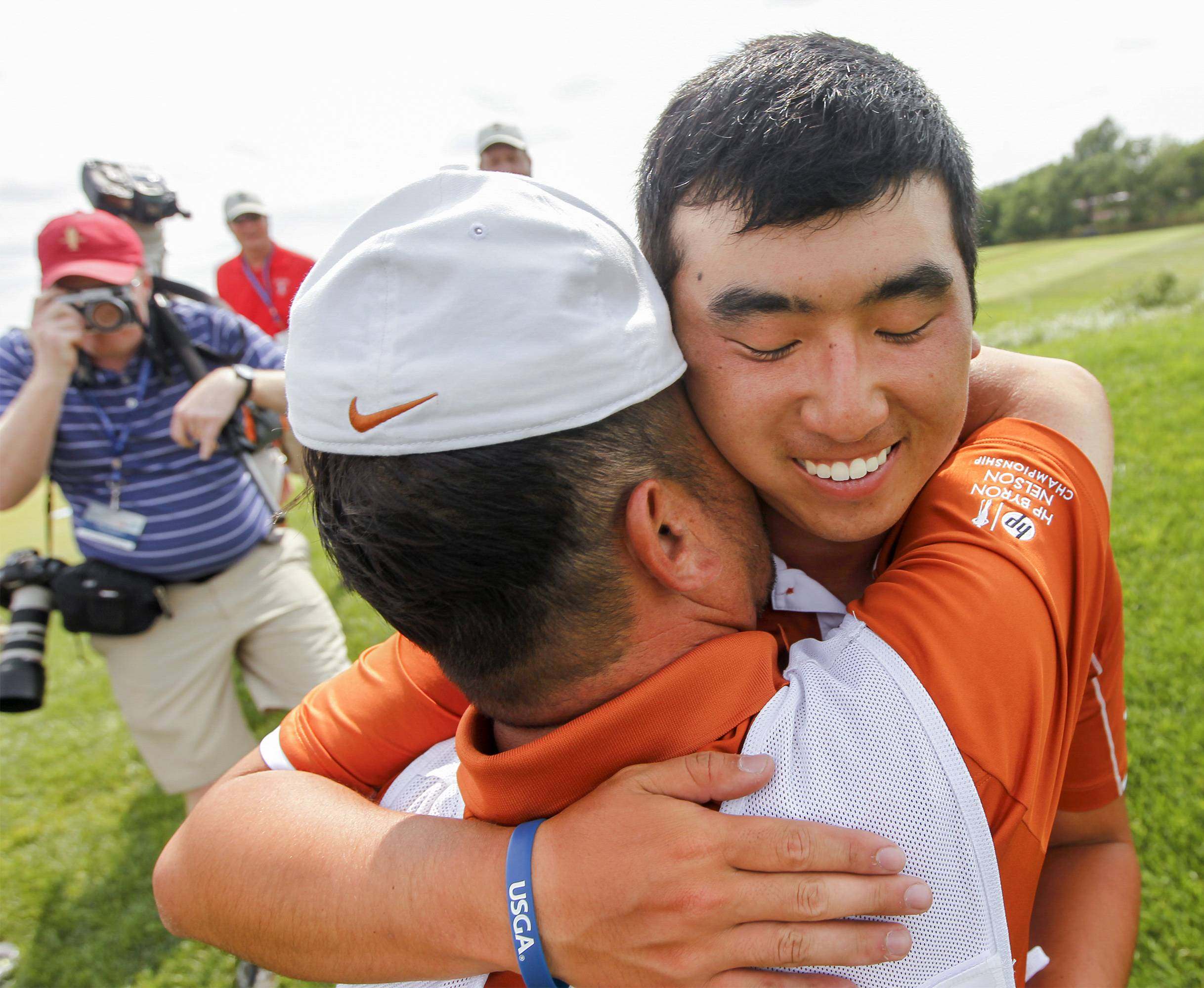Arlington Heights' Doug Ghim, hugging his father and caddie, Jeff, at the U.S. Amateur Public Links Championship earlier this month, is in the field of this week's marathon Western Amateur at Chicago's Beverly Country Club.