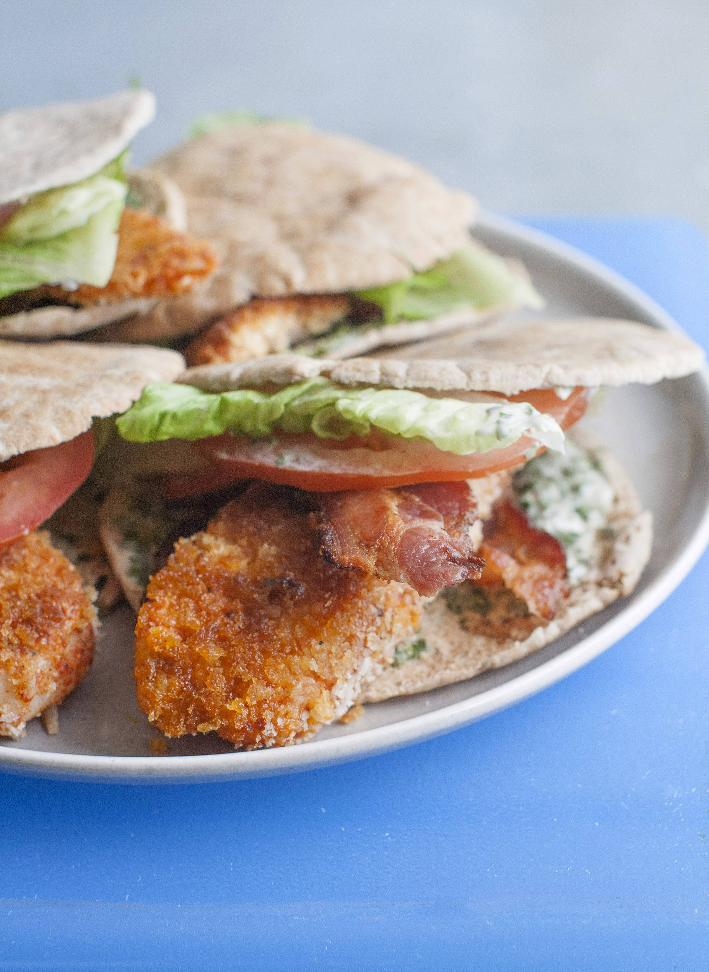 Tuck lightly breaded tilapia into a BLT pita for added flavor without much added fat.