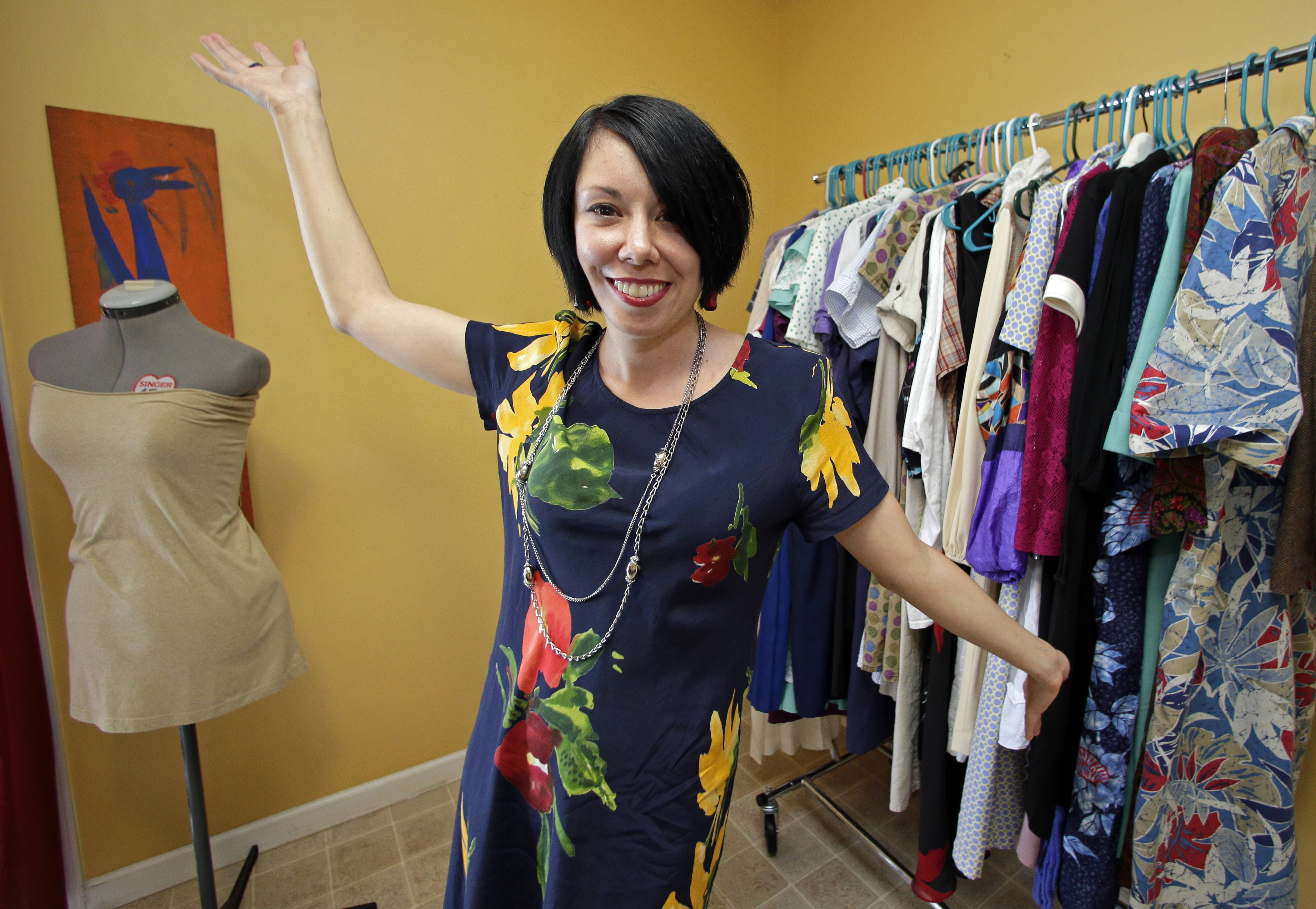 "Jillian Owens shows some of her thrift-store dresses at her home in Columbia, S.C. Since 2010, the 32-year-old Columbia resident has been delving into thrift store racks around the area, taking what some may see as ""ugly"" pieces and whipping them into hip, trendy fashions."