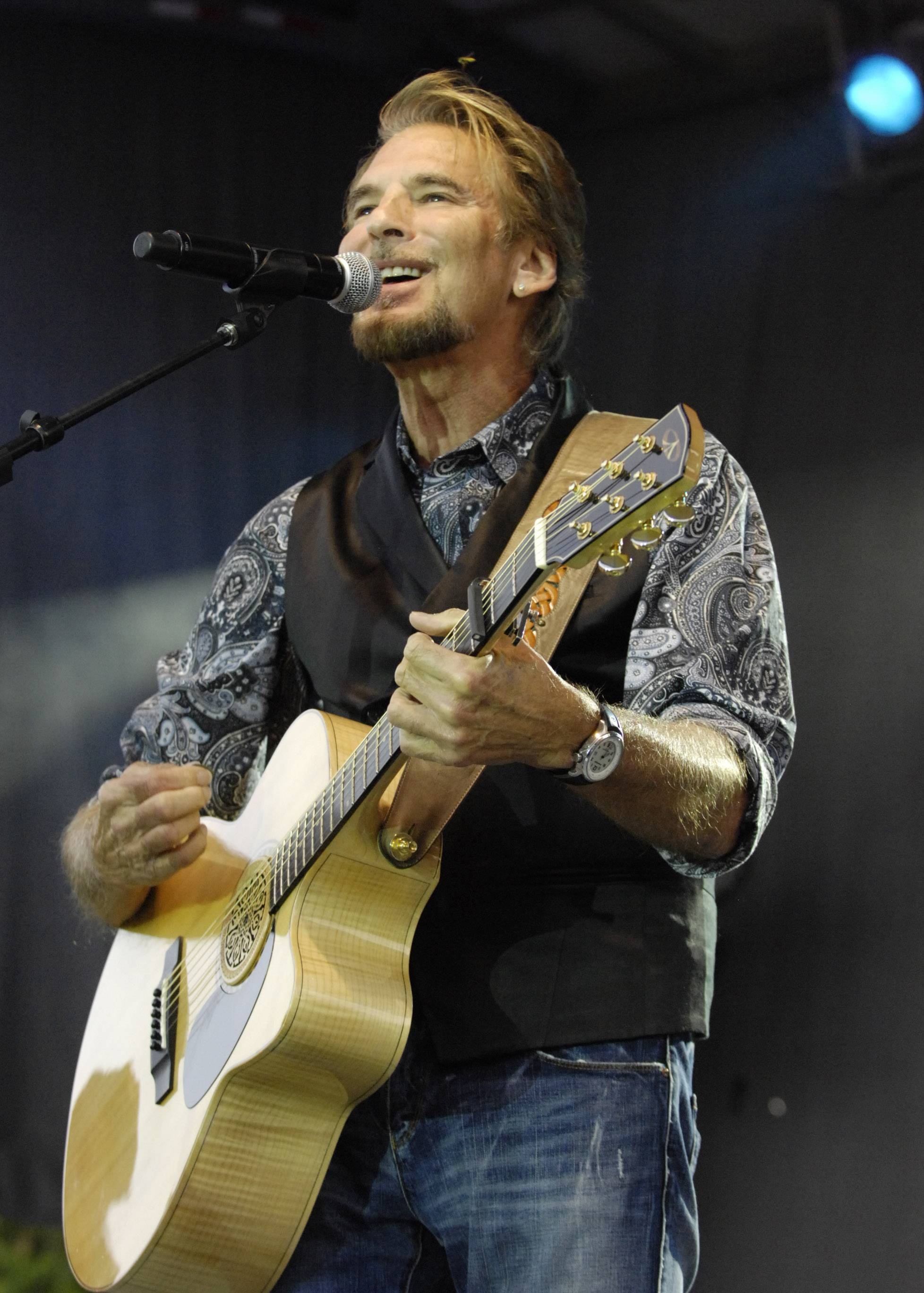 Kenny Loggins performs during the Elk Grove Village Mid-Summer Classic concert series on the Village Green Tuesday.