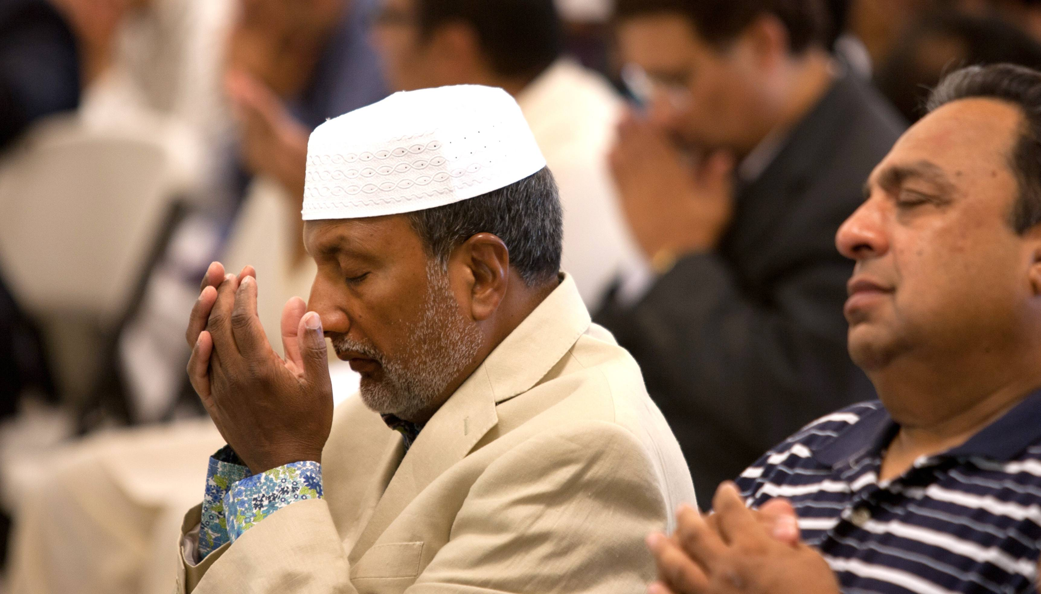 The Ahmadiyya Muslim Community prays and celebrates the end of Ramadan at their Glen Ellyn mosque.