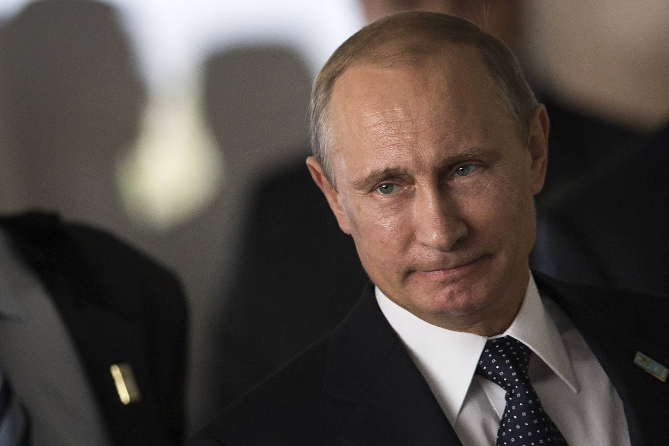 The United States and European Union on Tuesday curbed Russia's access to bank financing and advanced technology in its widest-ranging sanctions yet over President Vladimir Putin's backing of the rebels in eastern Ukraine. Putin is seen here.