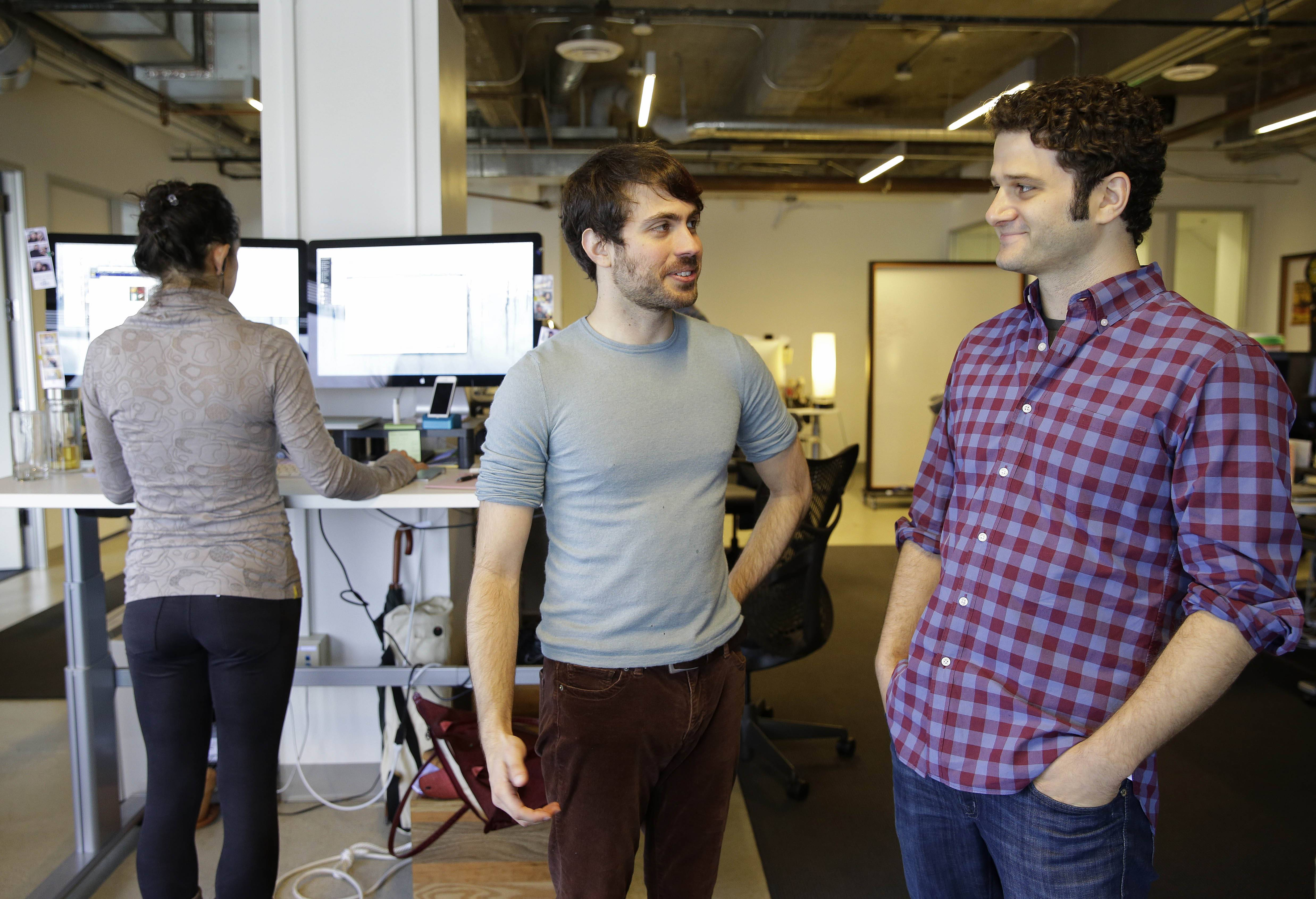 Asana co-founders Justin Rosenstein, center, and Dustin Moskovitz, right, at the company's headquarters in San Francisco.