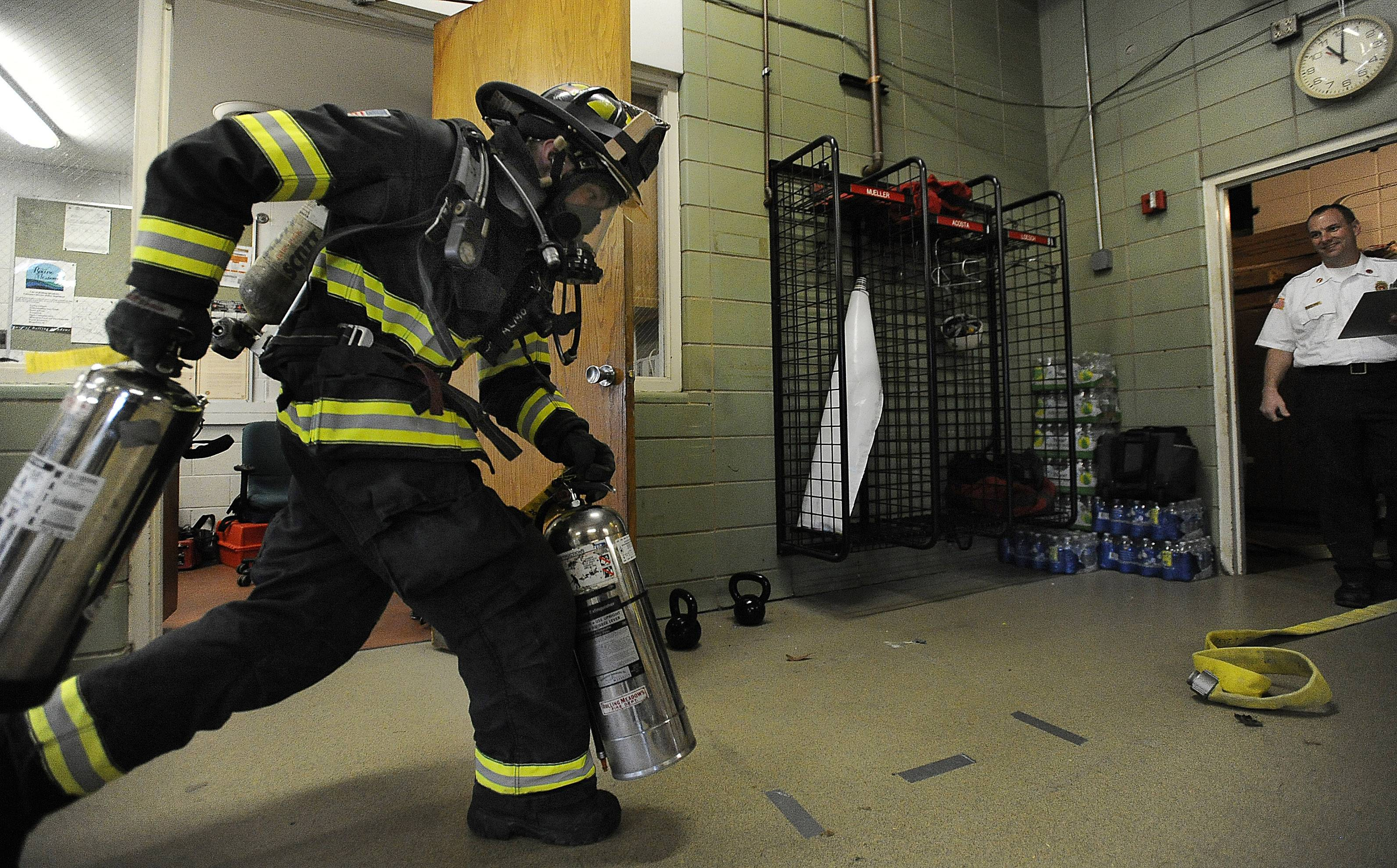 Gurnee has been awarded a $229,000 federal grant to mostly cover the cost of replacing 14-year-old air packs for firefighters. Rolling Meadows firefighter/paramedic John Loesch Jr. donned a pack for a drill last year.