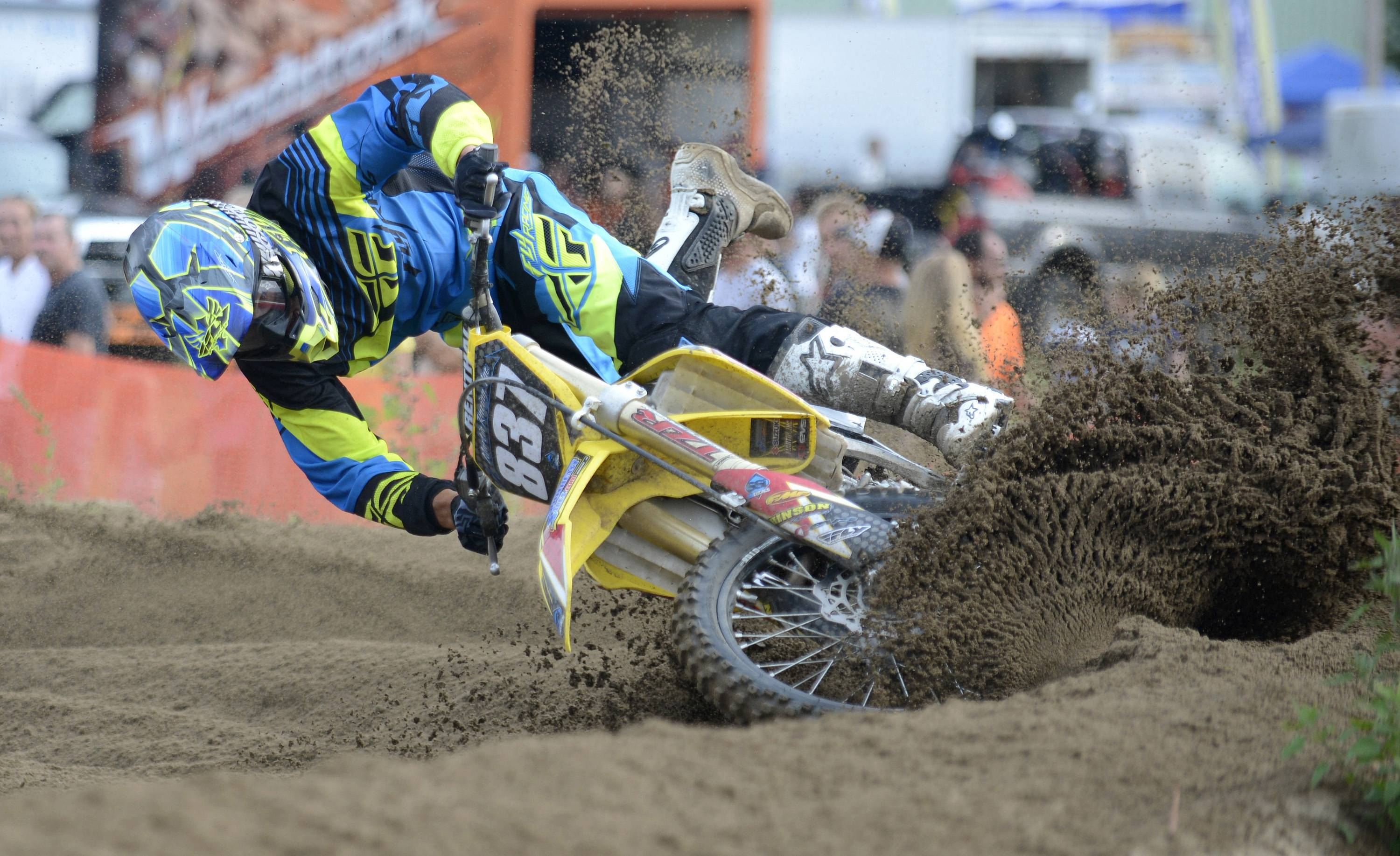 Ross Martin, 28, of Burlington, Wis., tips his bike in the deep dirt during the motocross race at last year's McHenry County Fair.