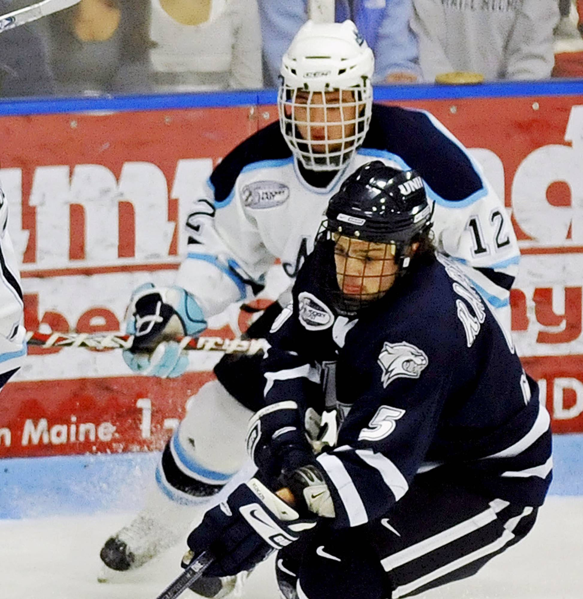 Kyle Solomon (12) suffered multiple concussions as a forward for Maine's ice hockey team from 2008 to 2010. One happened during a nationally televised game in 2009, when he was slammed into the boards and blacked out, according to filings. After receiving seven stitches in the locker room, he returned to the game in the final period.