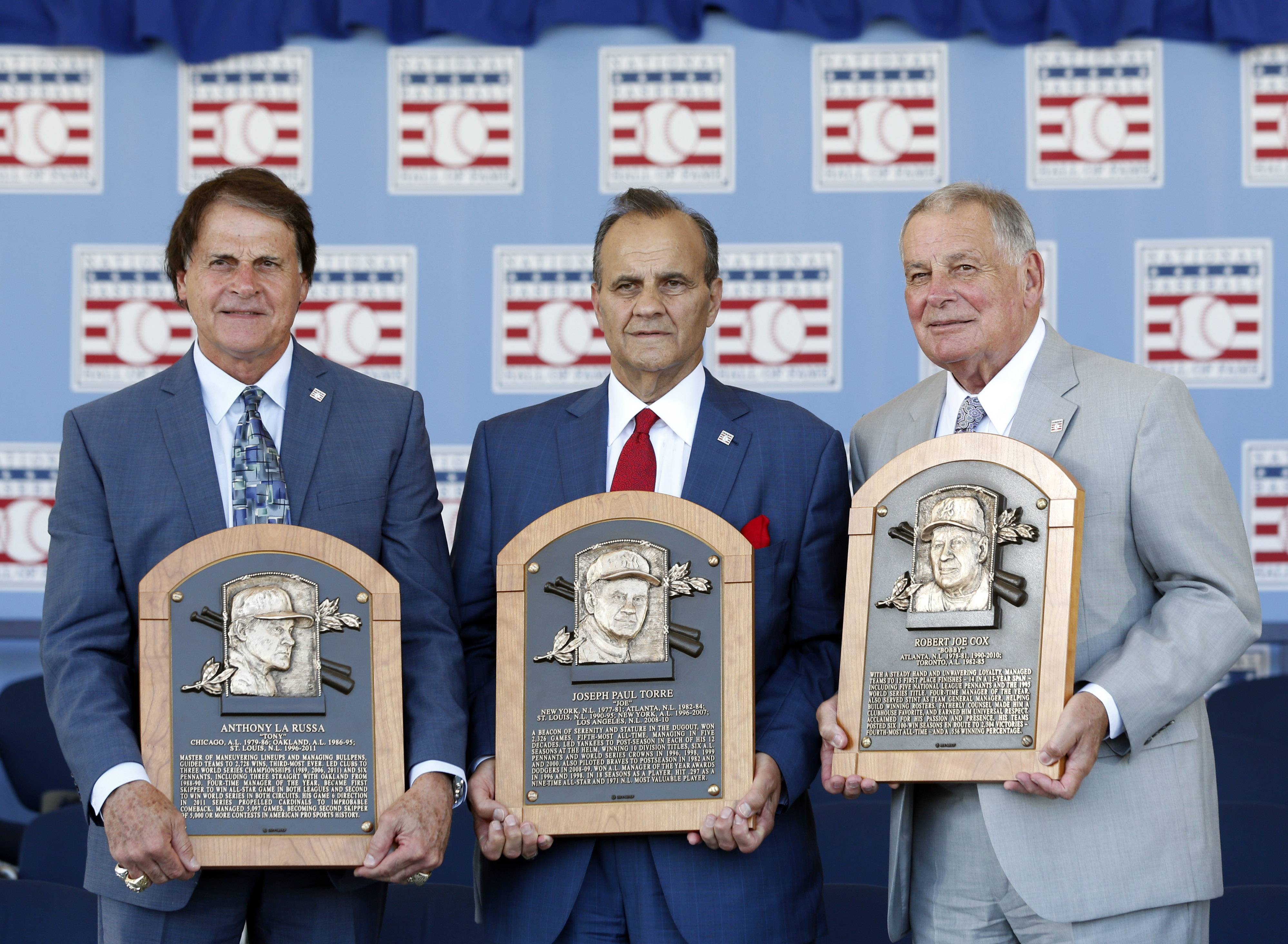 Mike North would gladly take new Hall of Famers Tony La Russa, from left, Joe Torre or Bobby Cox to manage his team.