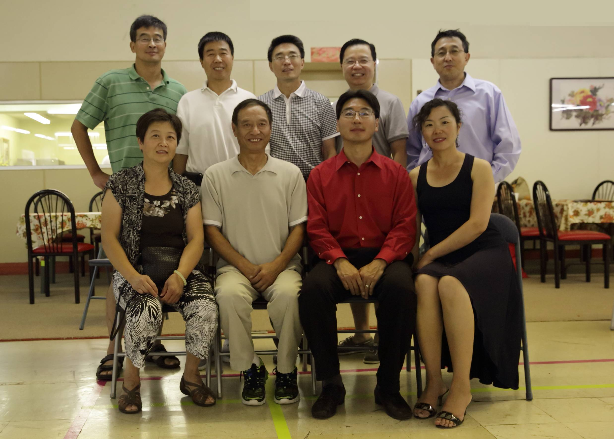 At the opening of the Epic Healthy Living Education Center in Mundelein, front row: Zhiping Lu, Jianhua Guo, Xiangdong Xu and Yaya Liu; back row: Xian Chen, James Wang, Ron Li, Denis Tian, Jinhe Li.
