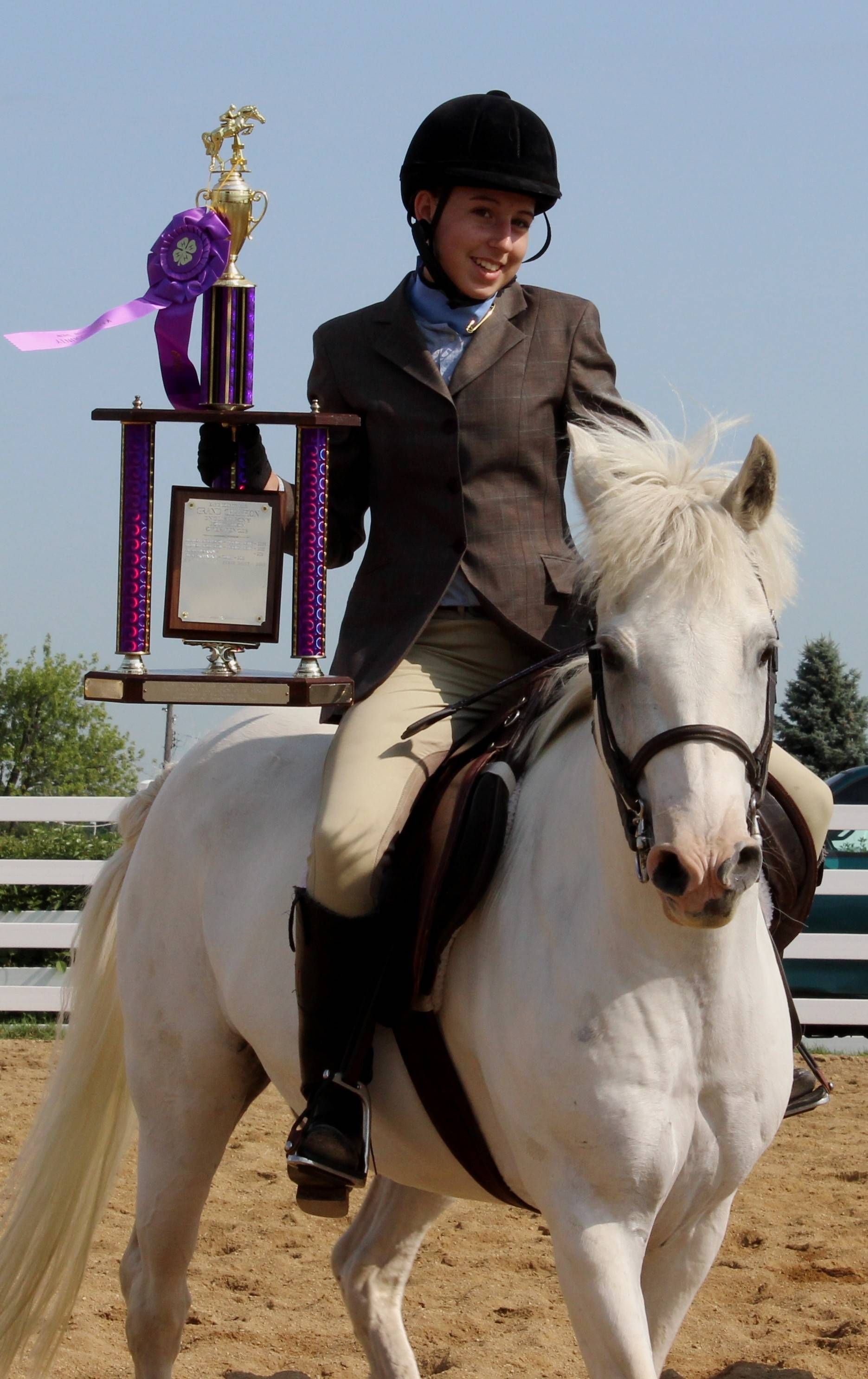 Audrey Gatsch of Wayne earned the Grand Champion trophy for English Pony Equitation over Fences on Thursday during the Kane County 4-H Show and Fair in St. Charles.