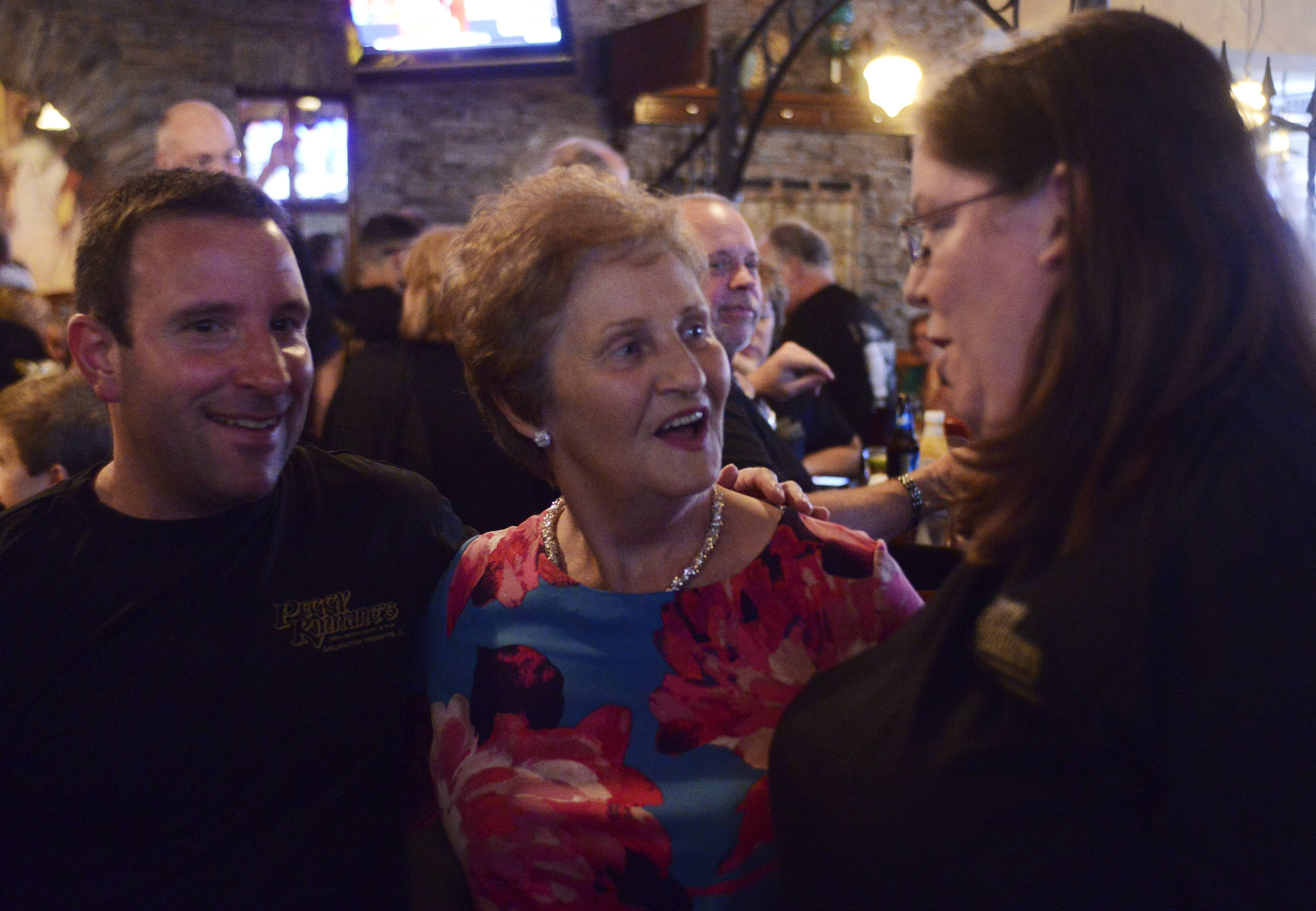 Peggy Kinnane, 75, namesake of the Arlington Heights restaurant and mother of owner Derek Hanley, chats with Chip Iuorio, left, and Karin Weizel, both of Palatine, while posing for photos Wednesday night during a visit from Ireland.