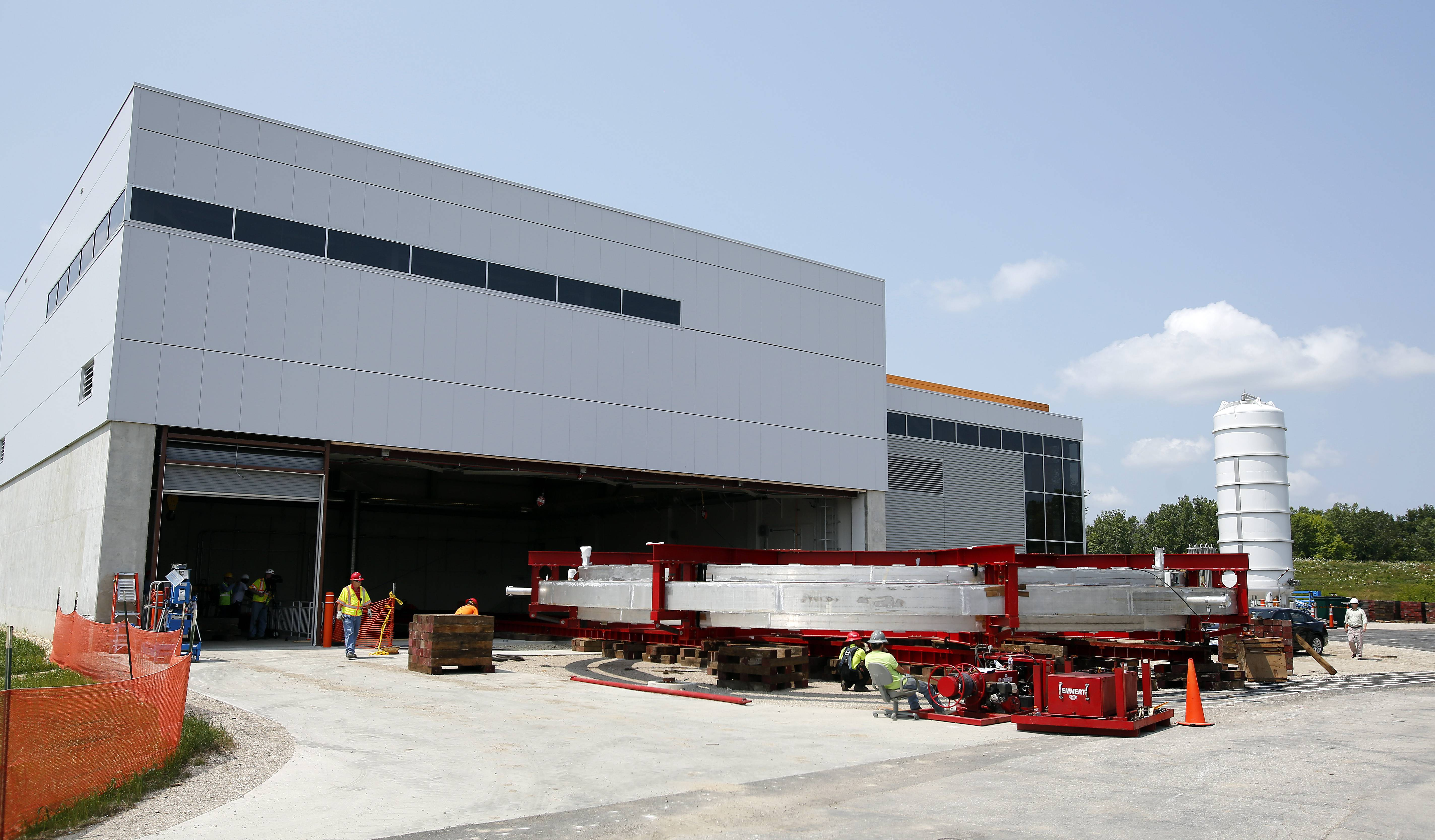 The gigantic Muon g-2 electromagnet is moved — slowly — into its new building Wednesday at Fermilab in Batavia.