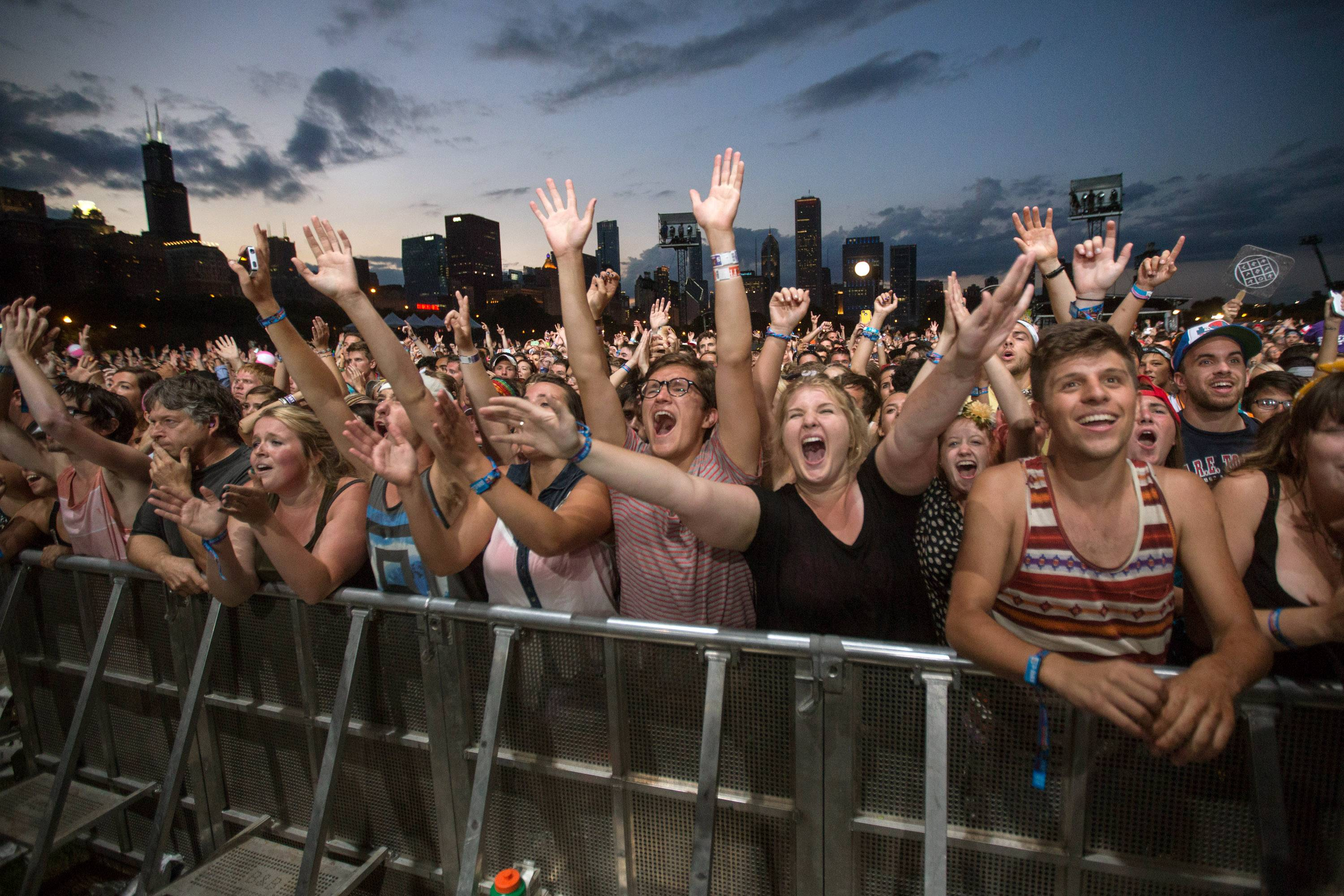 This 2013 file photo shows fans reacting while Mumford & Sons performs at the Lollapalooza Festival in Chicago.