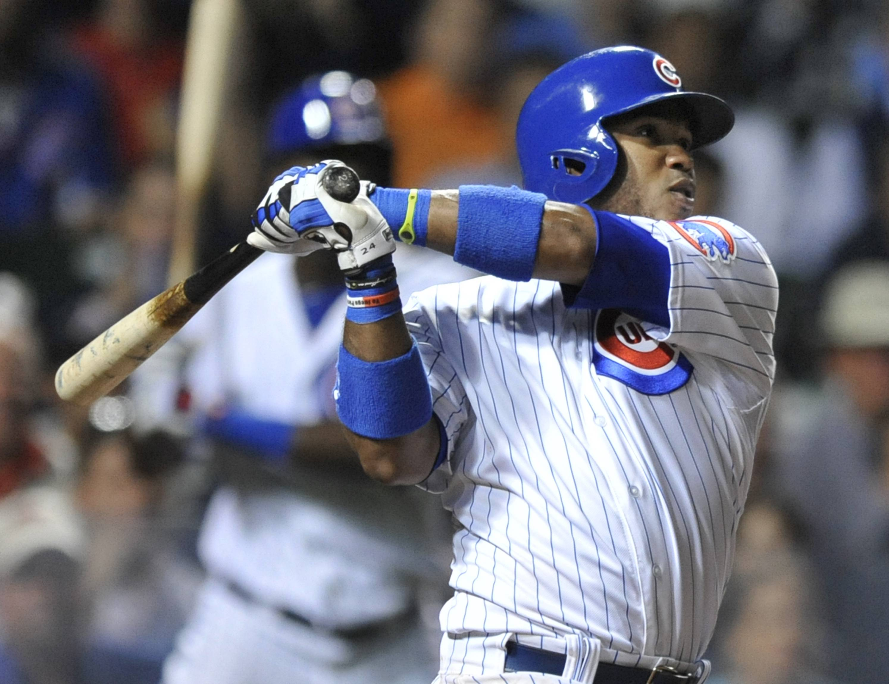 The Cubs' Luis Valbuena watches his 2-run, game-tying homer in the eighth inning Wednesday night. The Rockies won 6-4 in 10 innings.