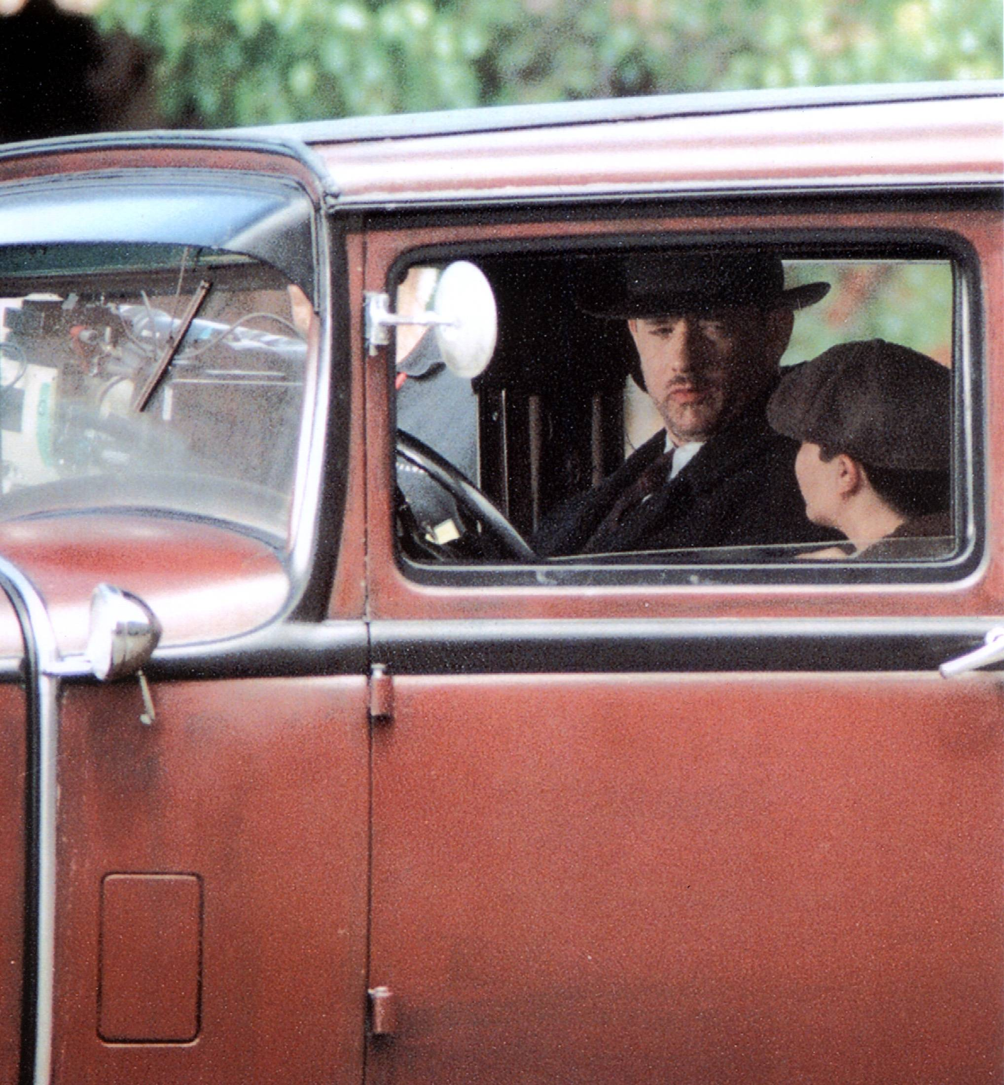 "COURTESY OF DAN ELLIOTTTom Hanks and Tyler Hoechlin film a scene on the set of the movie ""Road to Perdition"" in Geneva in 2001. The film was based on a graphic novel by Max Allan Collins."