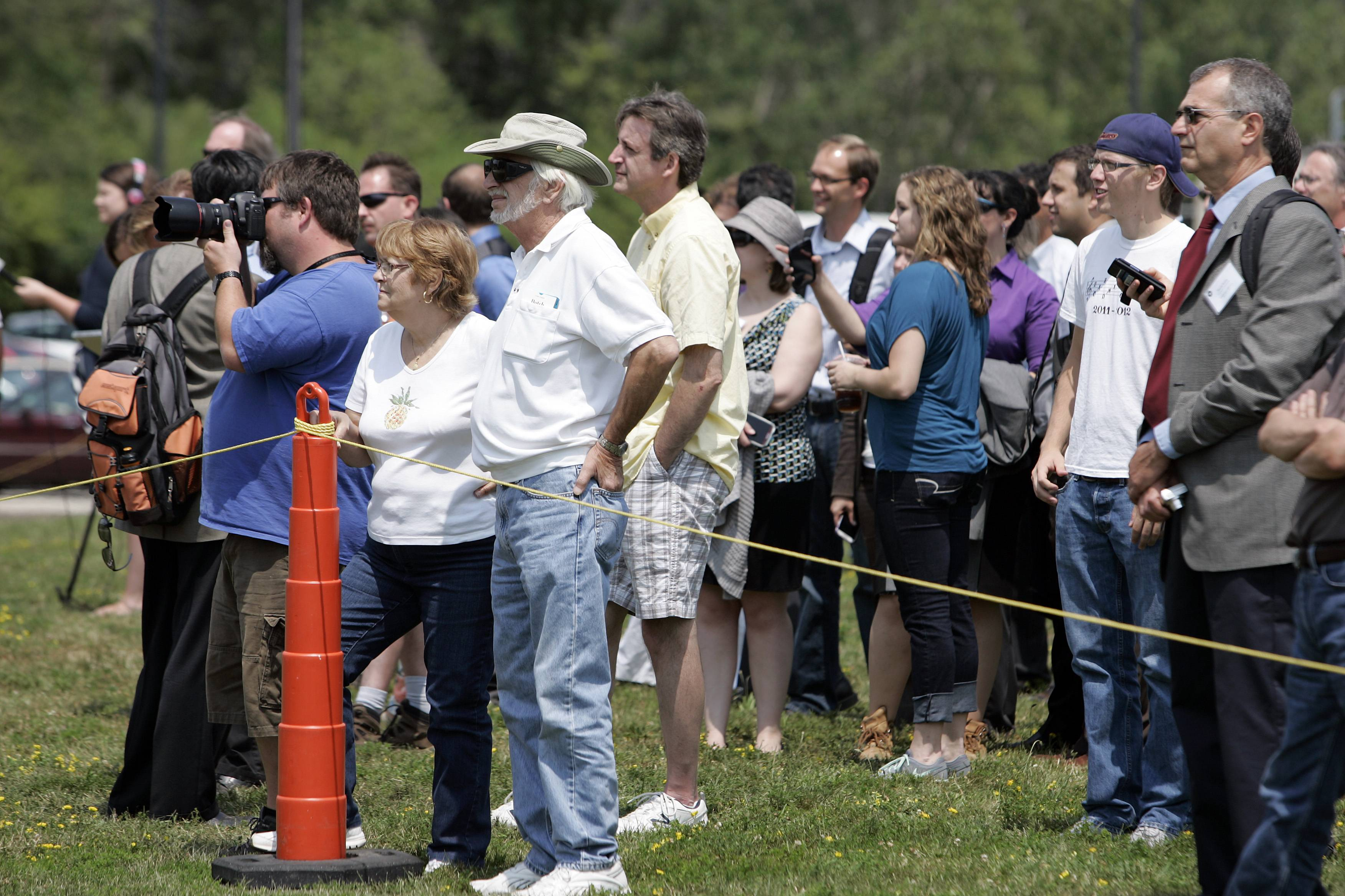 Hundreds of onlookers watch as the gigantic Muon g-2 electromagnet is moved Wednesday into its new building at Fermilab.