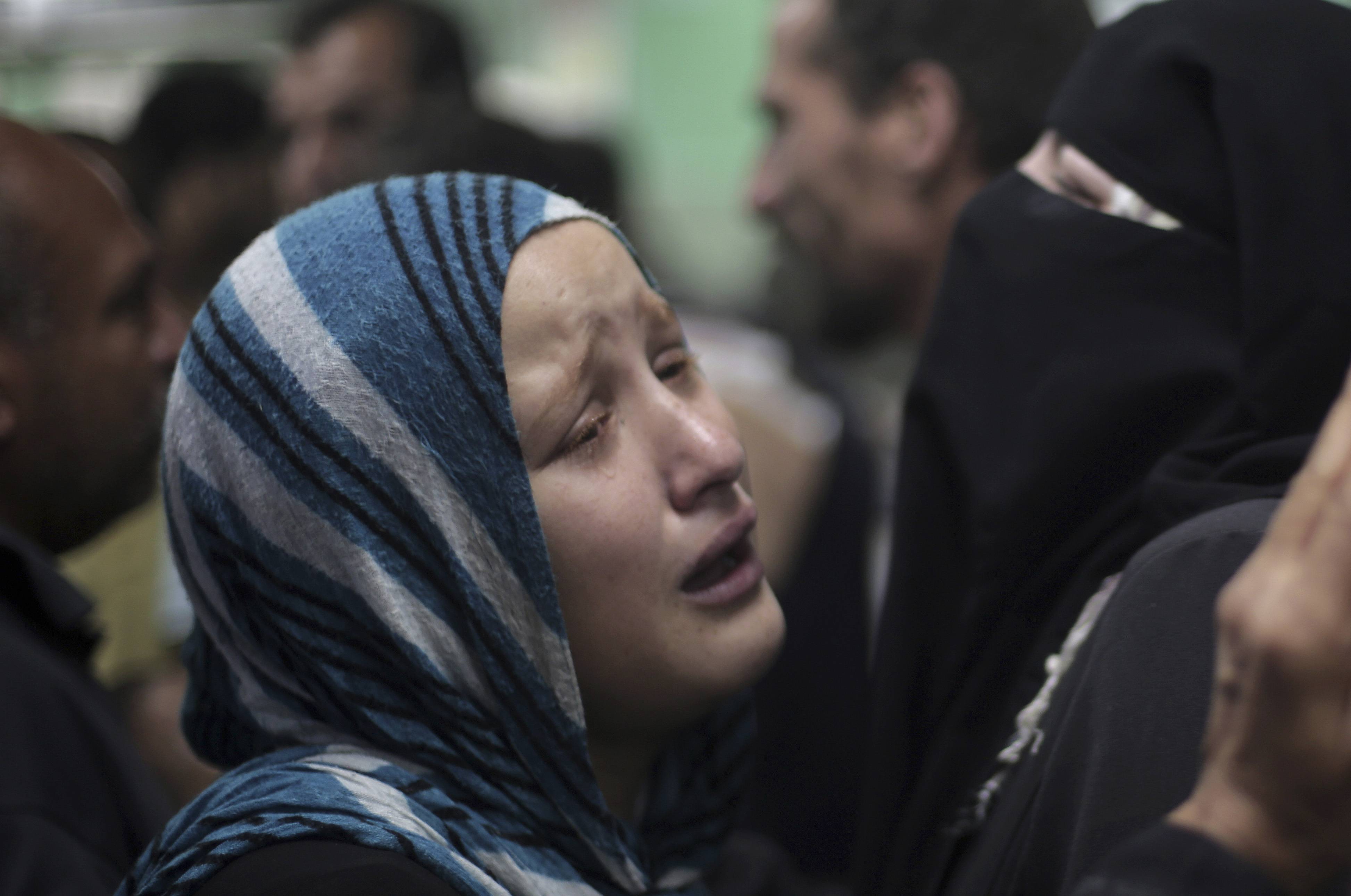 Palestinians grieve the death of their relatives who were killed in an Israeli strike at a U.N. school in Jebaliya refugee camp, at a hospital in Beit Lahiya, northern Gaza Strip, Wednesday.