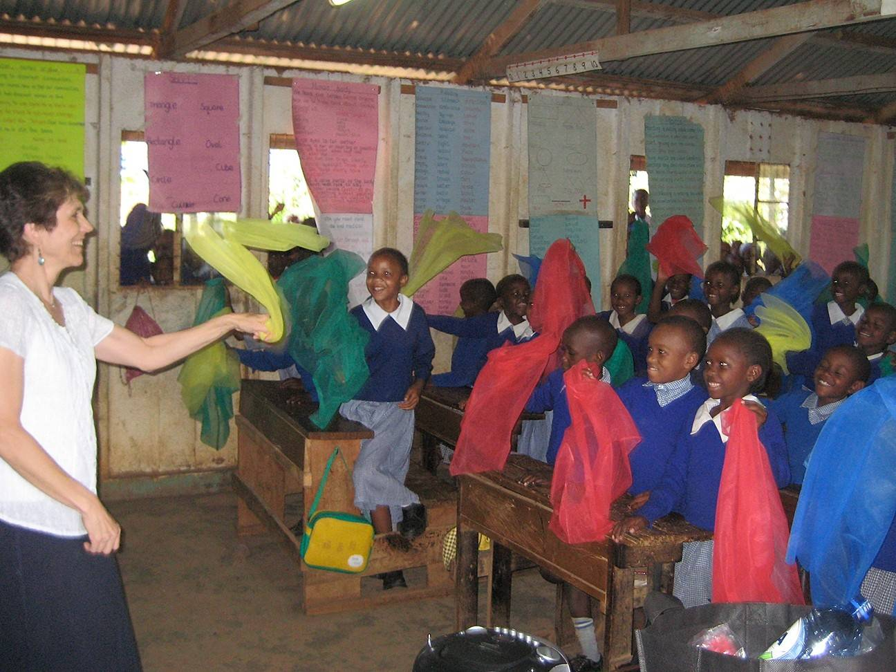Kathy Cathey, a music instructor in the Community School of the Arts at Wheaton College, teaches music during a visit to Kinyago-Dandora School in the slums of Nairobi, Kenya.