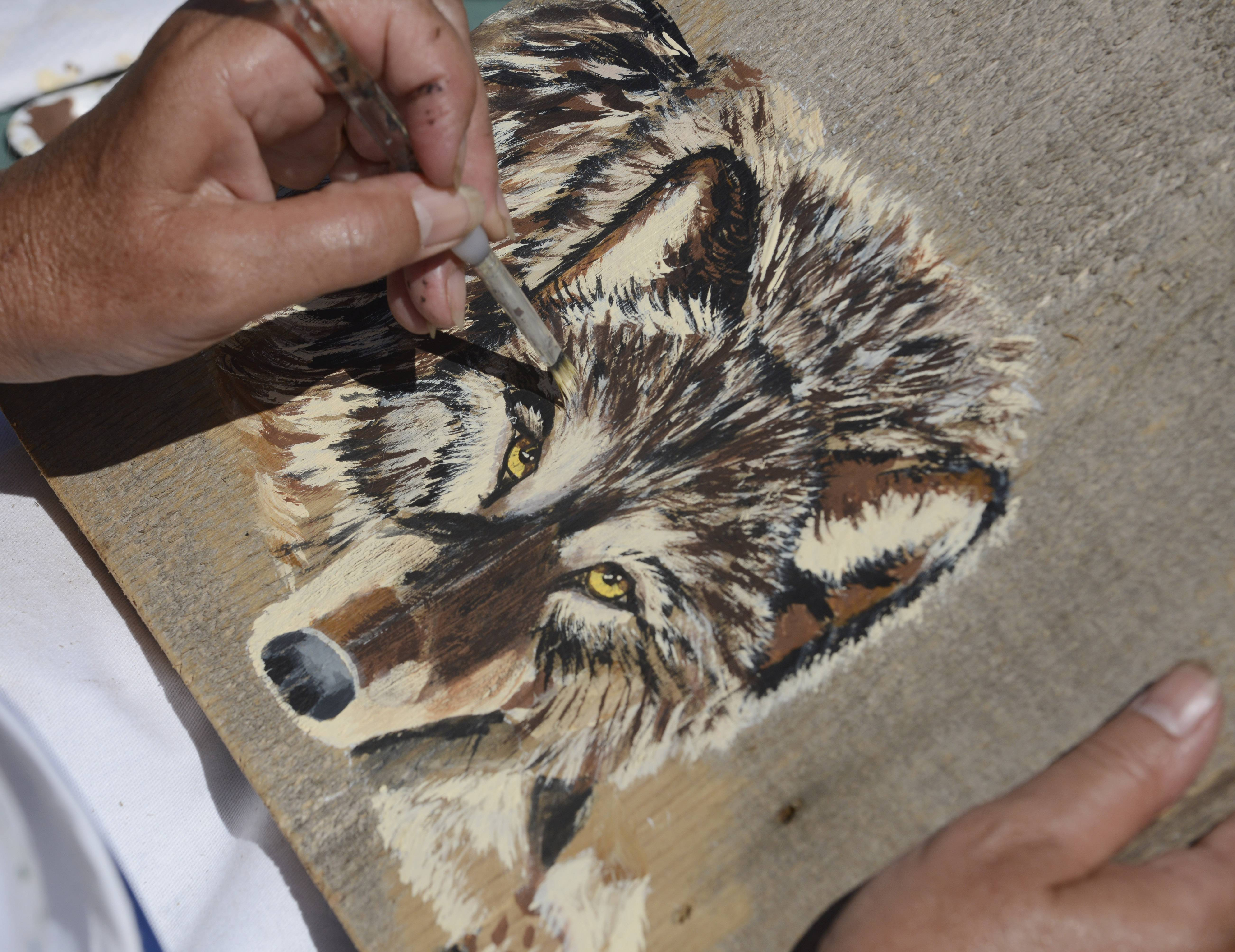 An image of a wolf using acrylic on antique barn wood was among the offerings last year during the David Adler Music and Arts Center Festival of the Arts at Cook Park in Libertyville.