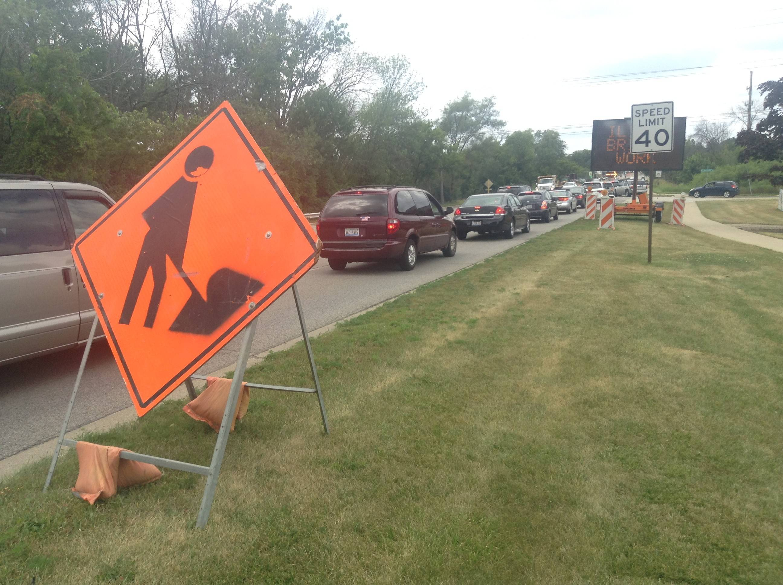 Traffic backs up on westbound Grand Avenue as crews prepares for Des Plaines River bridge reconstruction this week in Gurnee. Warren Township High School officials are encouraging parents to not drive their children to the O'Plaine Road campus for freshmen and sophomores.