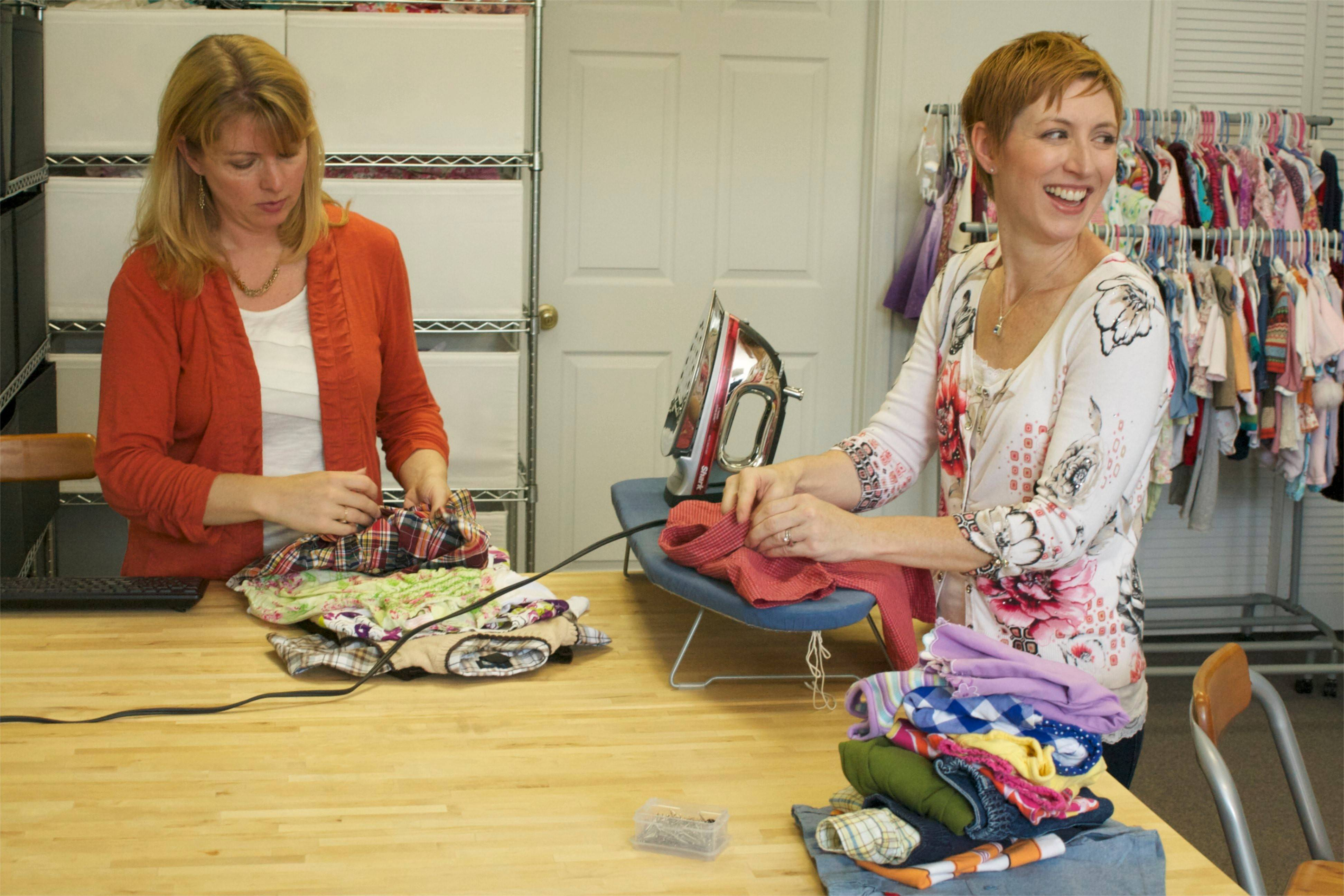 Sisters Sandra Pinter, left, and Sharon Schneider, co-founders of e-commerce site MoxieJean.com, prepare some of the used clothing for resale.