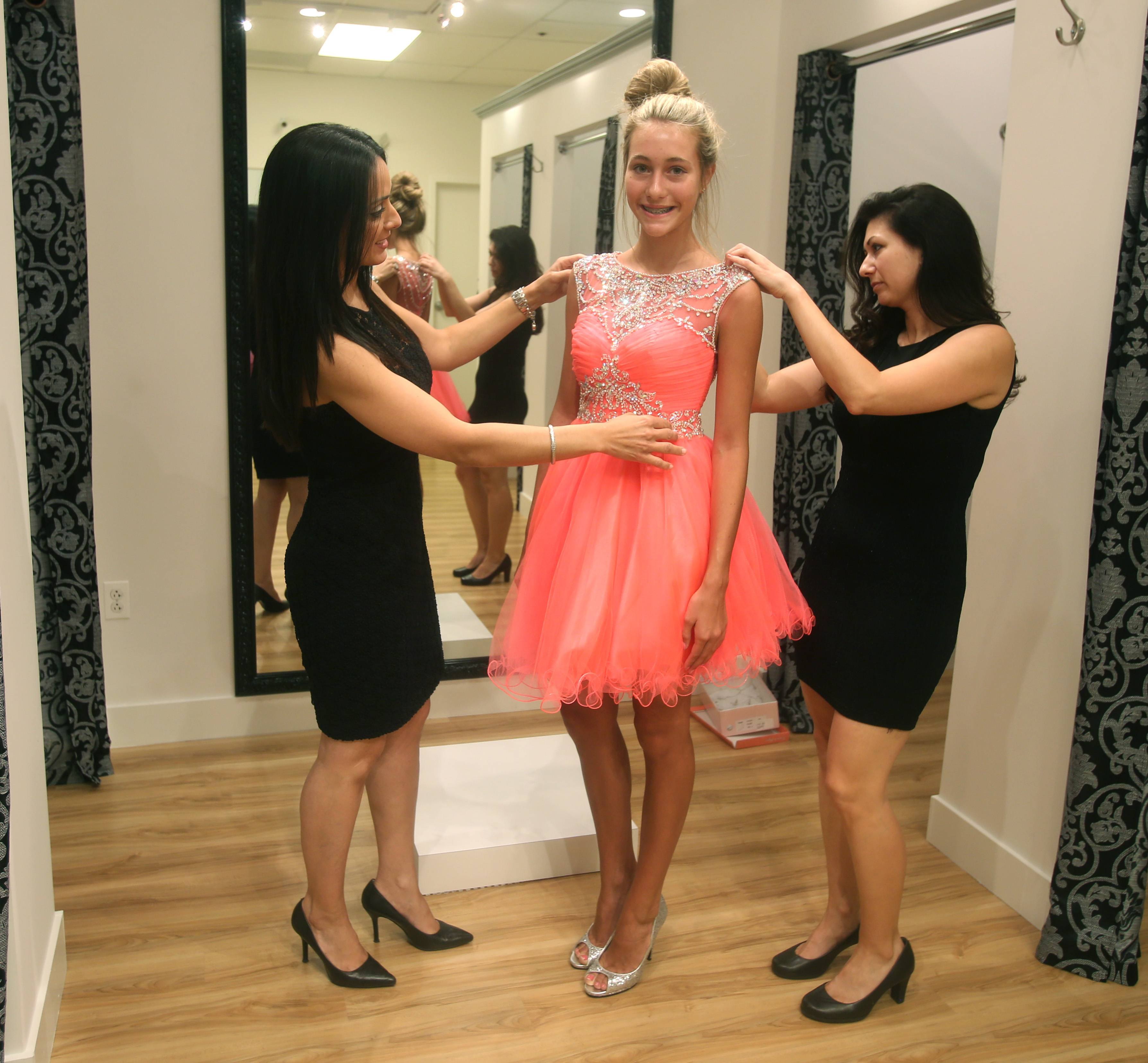 Bri'Zan Couture owner Sue Zanayed-Cerulli, left, and employee Tara Molinero fit a homecoming dress for Aliyah Hoff of Yorkville.