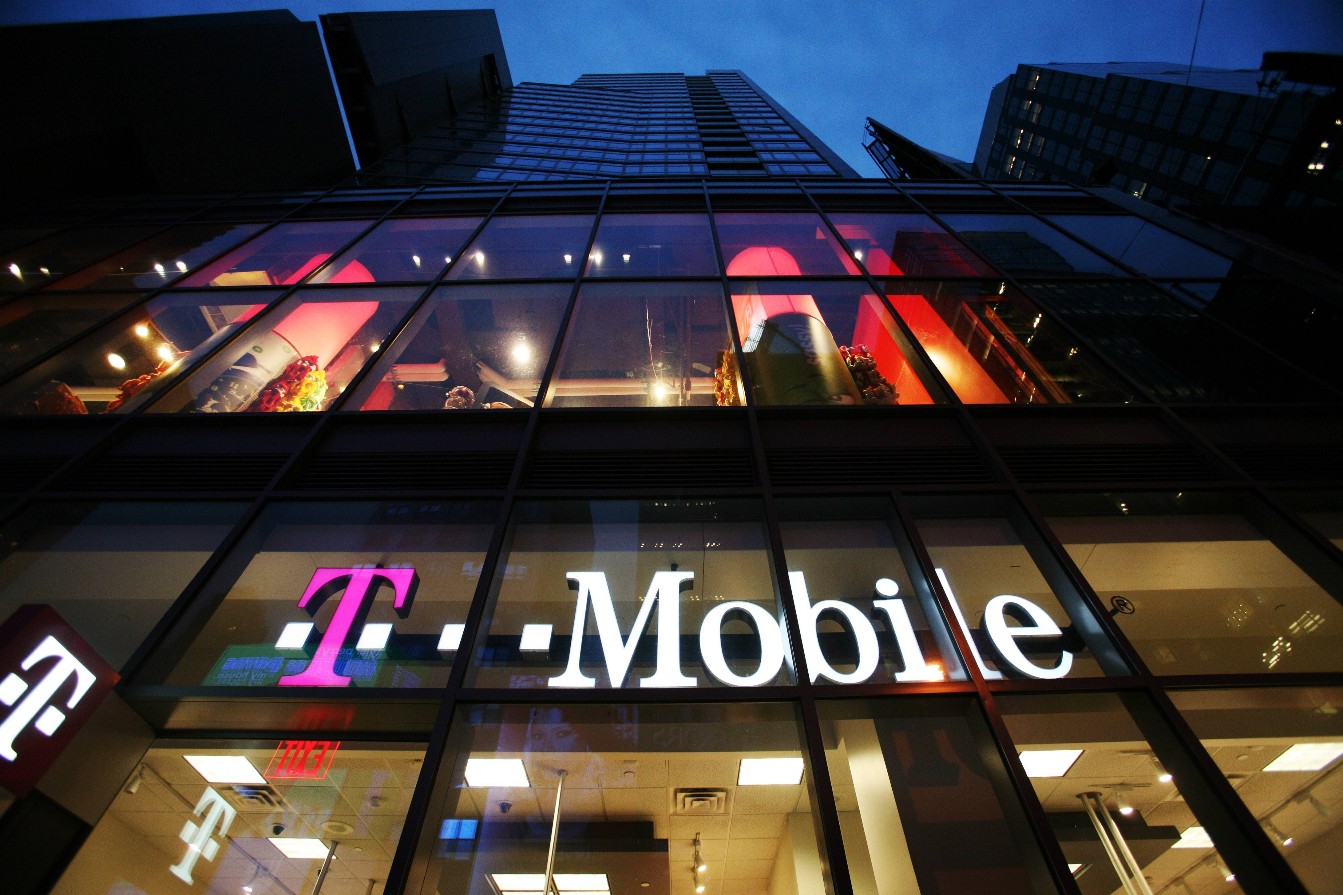 T-Mobile US Inc. added more customers than analysts estimated and raised its forecast for subscriber growth as the carrier continues to challenge rivals with cheaper plans and promotions.