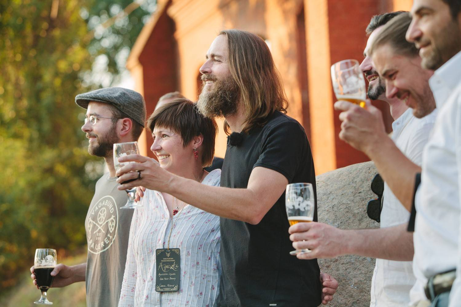 Stone Brewing Co. CEO and co-founder Greg Koch, center, toasts the crowd on July 19 after announcing that the Escondido, Calif., brewery plans to build a brewery and bistro in Berlin.