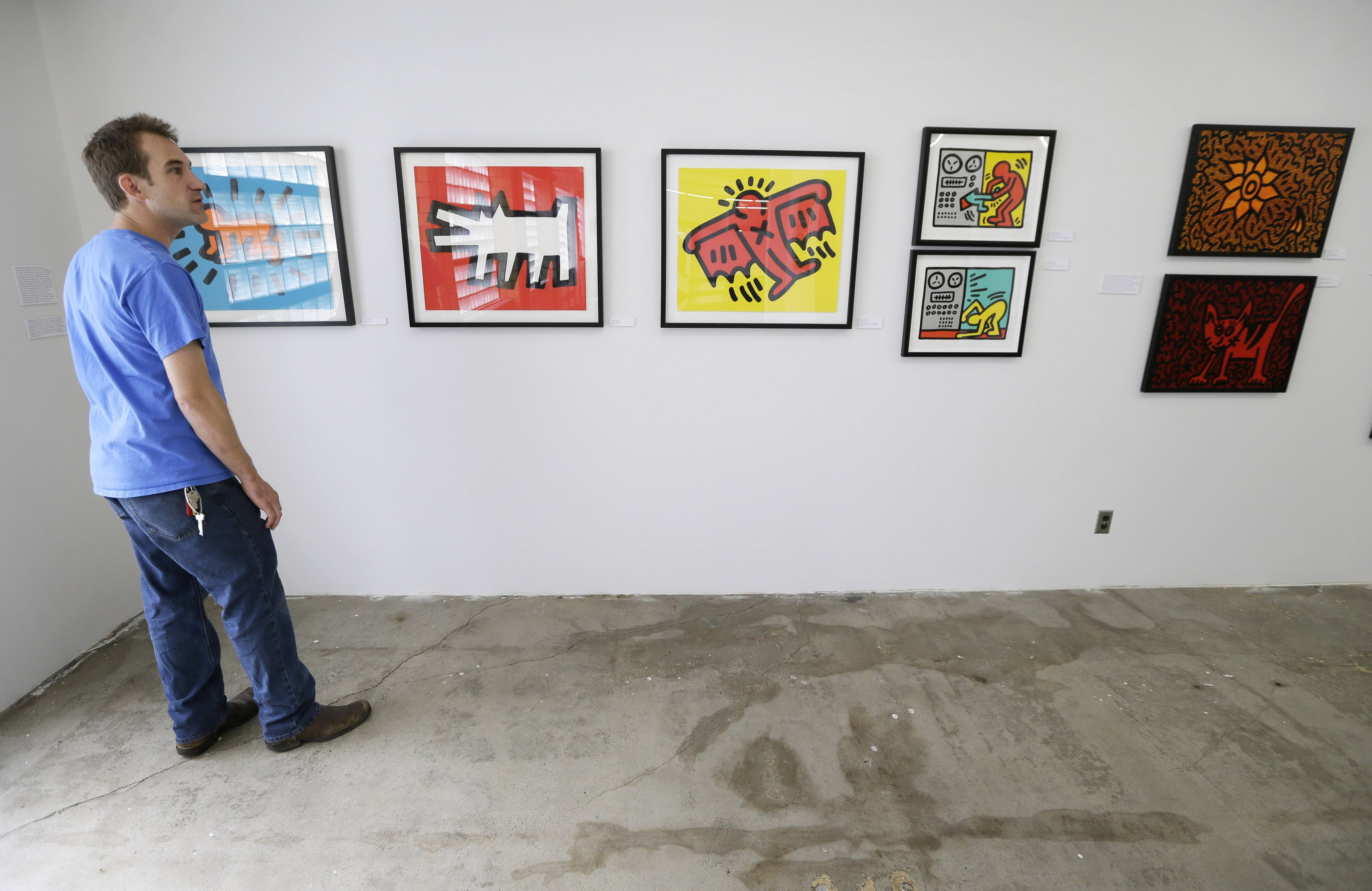 Curtis Porter, of Des Moines, Iowa, looks at art on display in the Des Moines Social Club.