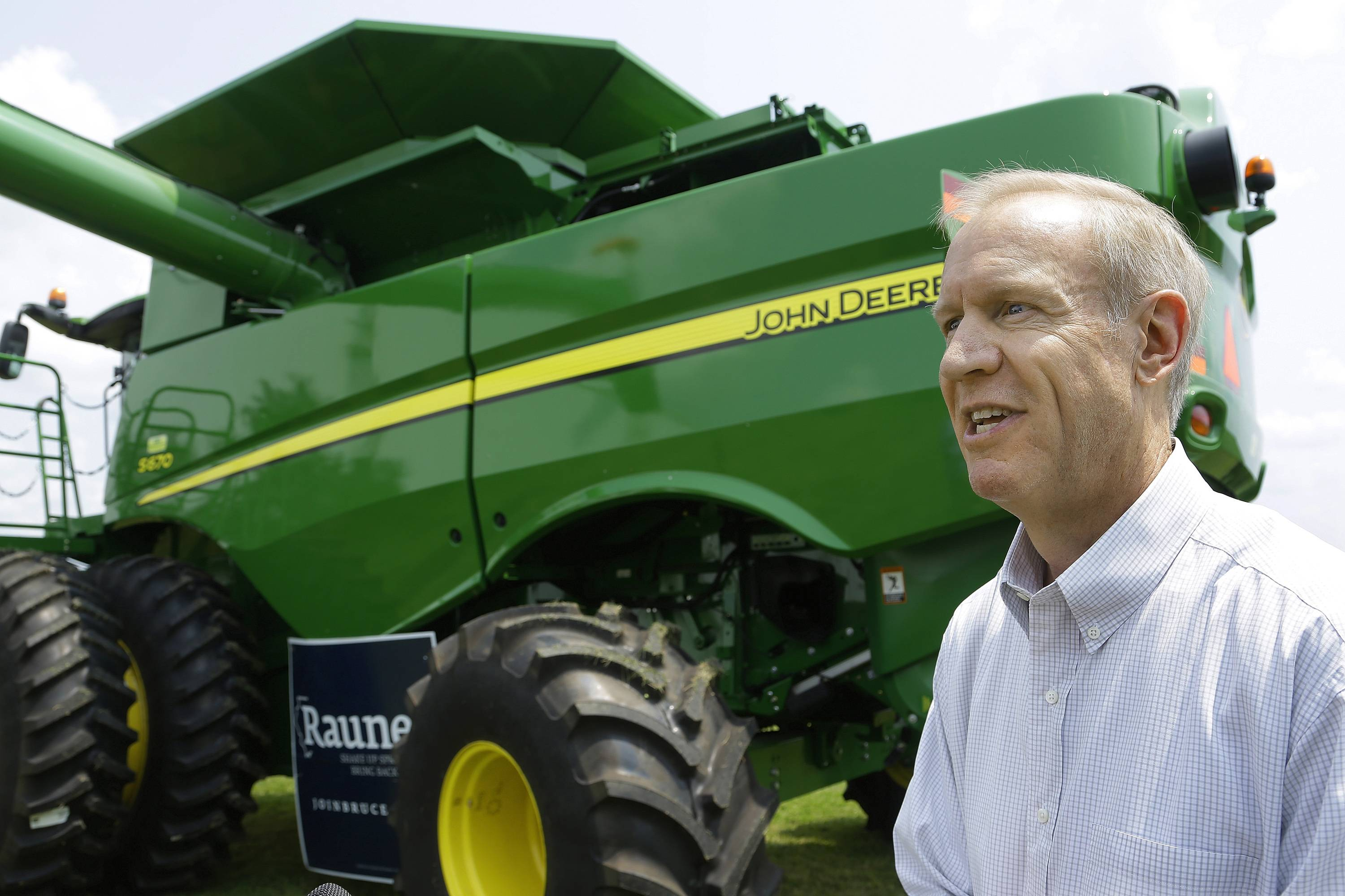 Republican candidate for governor Bruce Rauner talks to farmers Thursday in downstate Lincoln.