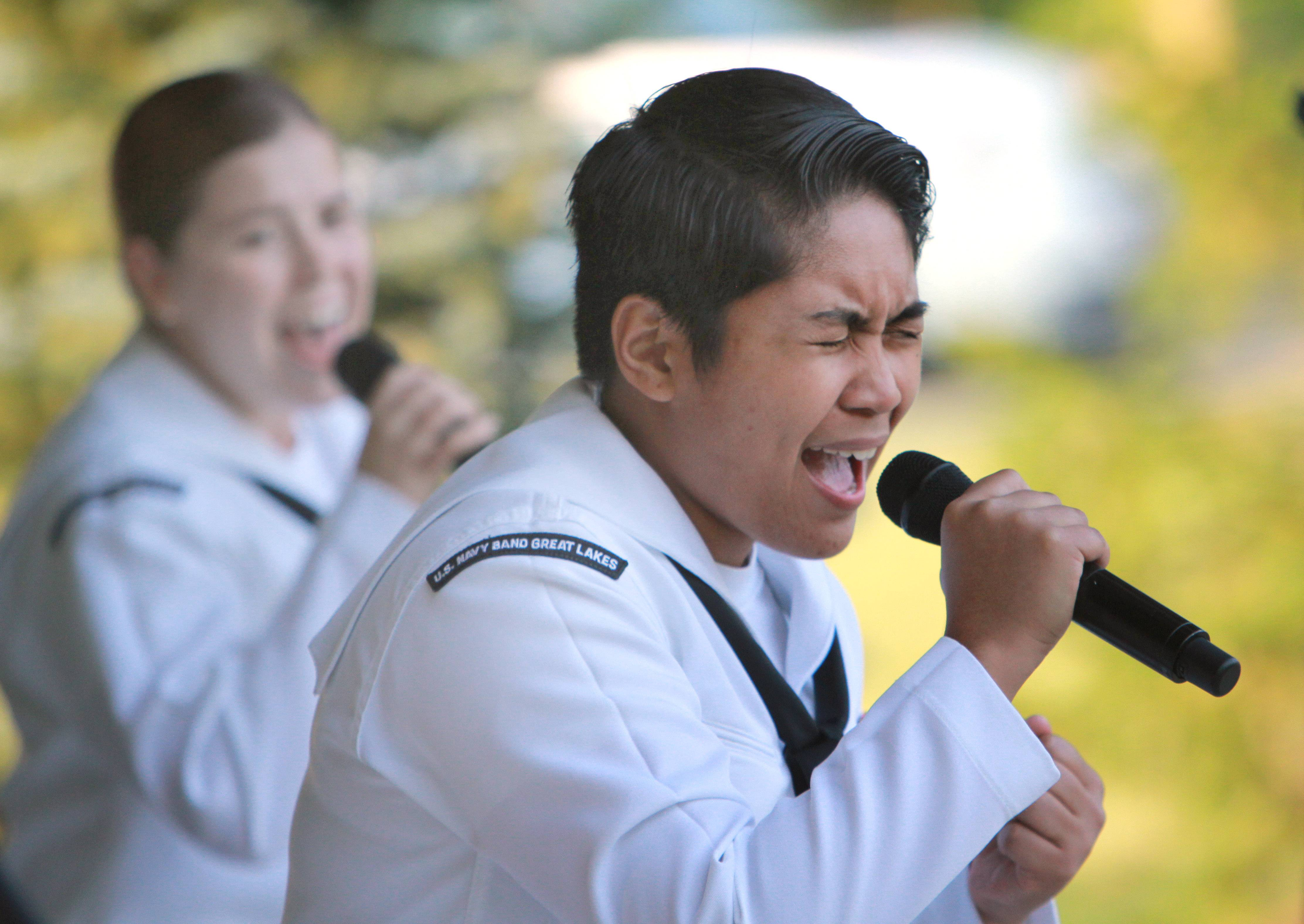 Danlie Cuenca, right, and Danielle Clark entertain the crowd Wednesday night as The Great Lakes naval band Horizon rocked out at Engle Memorial Park in Lindenhurst.