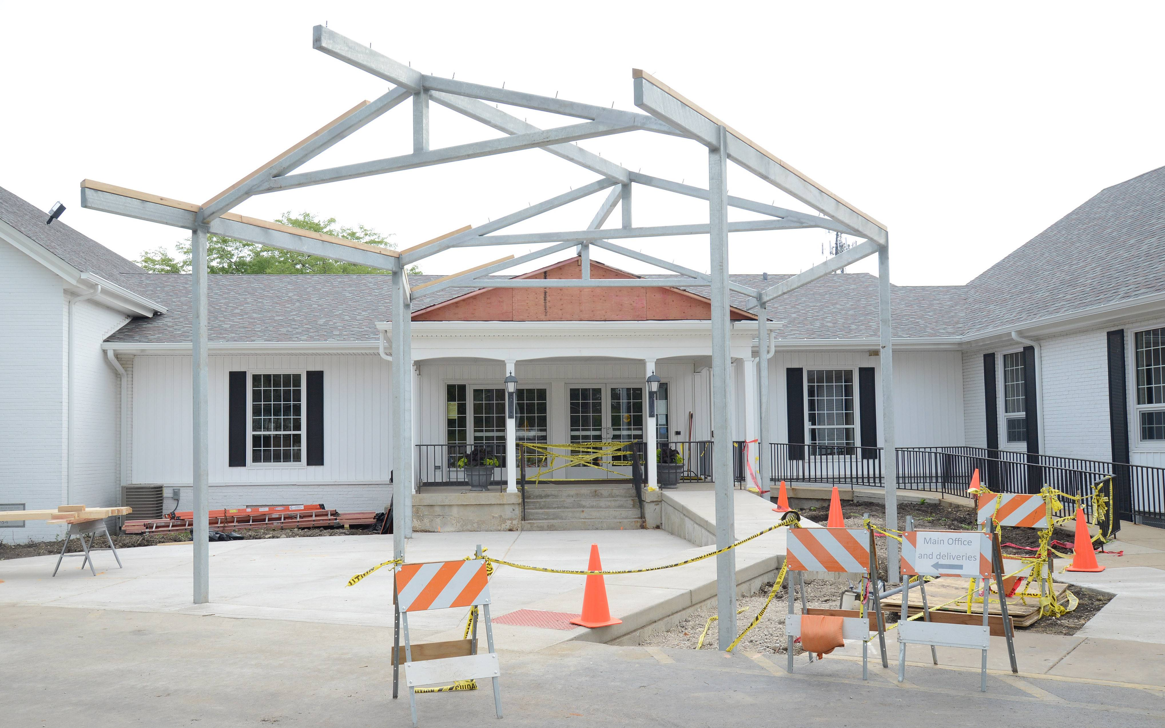 A canopy over the main entrance of the First Baptist Church of Geneva's east campus was worked on Thursday.