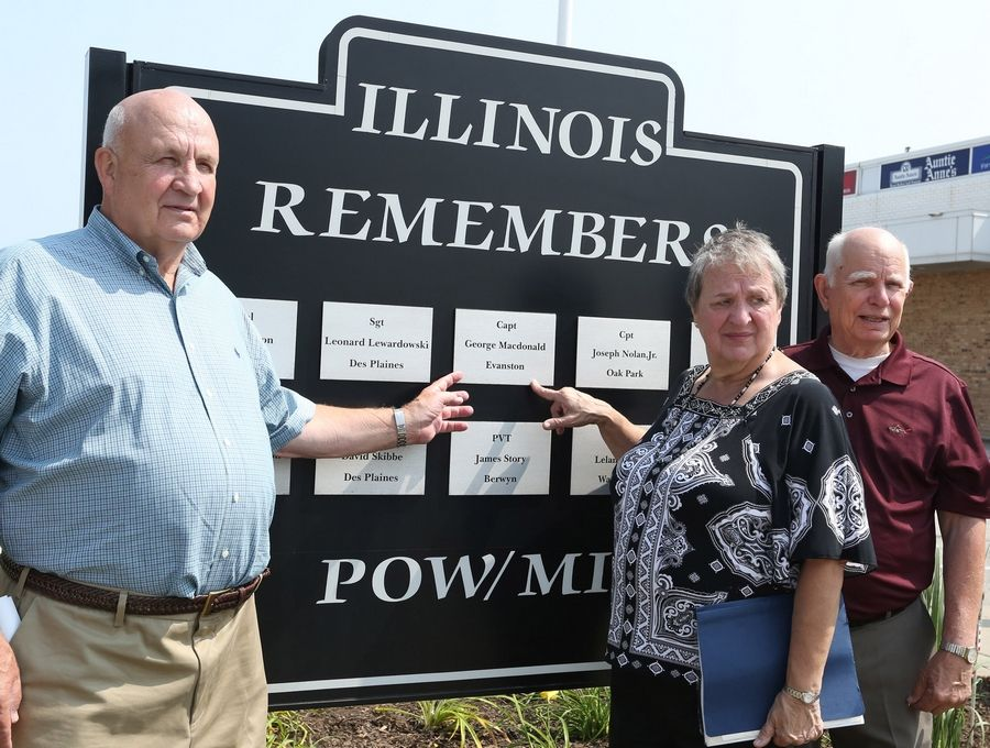 Ben Macdonald, his sister Jeanette Frye and her husband, Ed, right, pay tribute Thursday to George Macdonald, who was declared MIA in Vietnam.