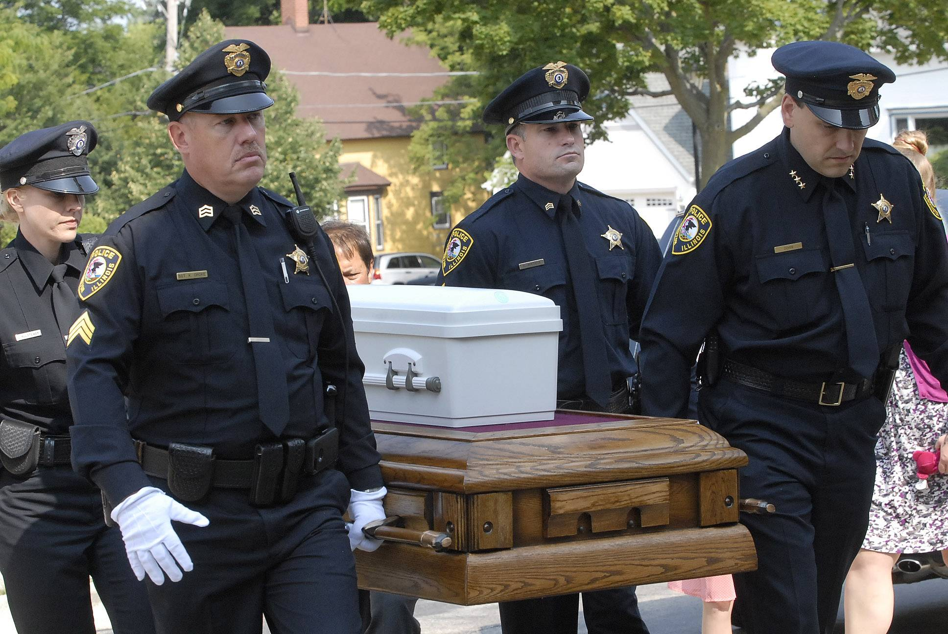 Pallbearers carry the casket of 7-month-old Mya Edwards, who starved to death in January, into St. Anne Catholic Church in Barrington before her funeral Thursday.