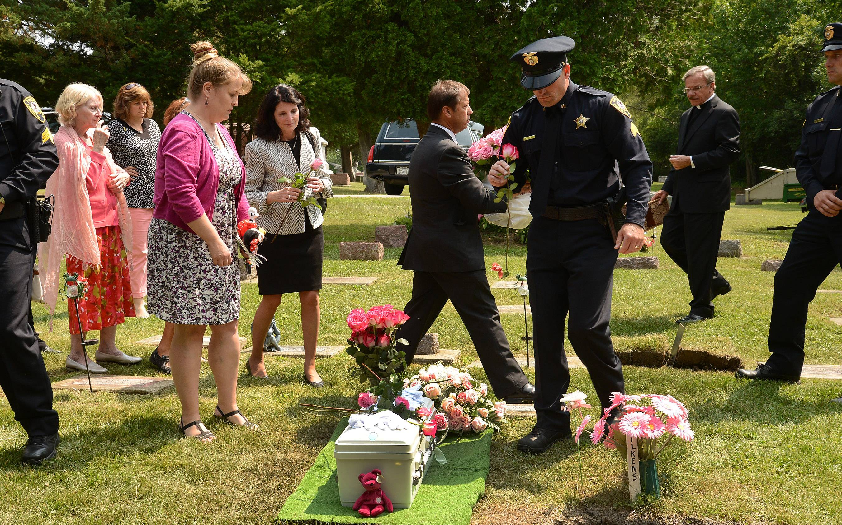 Mya Edwards, a 7-month-old girl who starved to death in January, is laid to rest Thursday during a ceremony in Barrington. The funeral was organized by a suburban nonprofit group and Barrington officials.