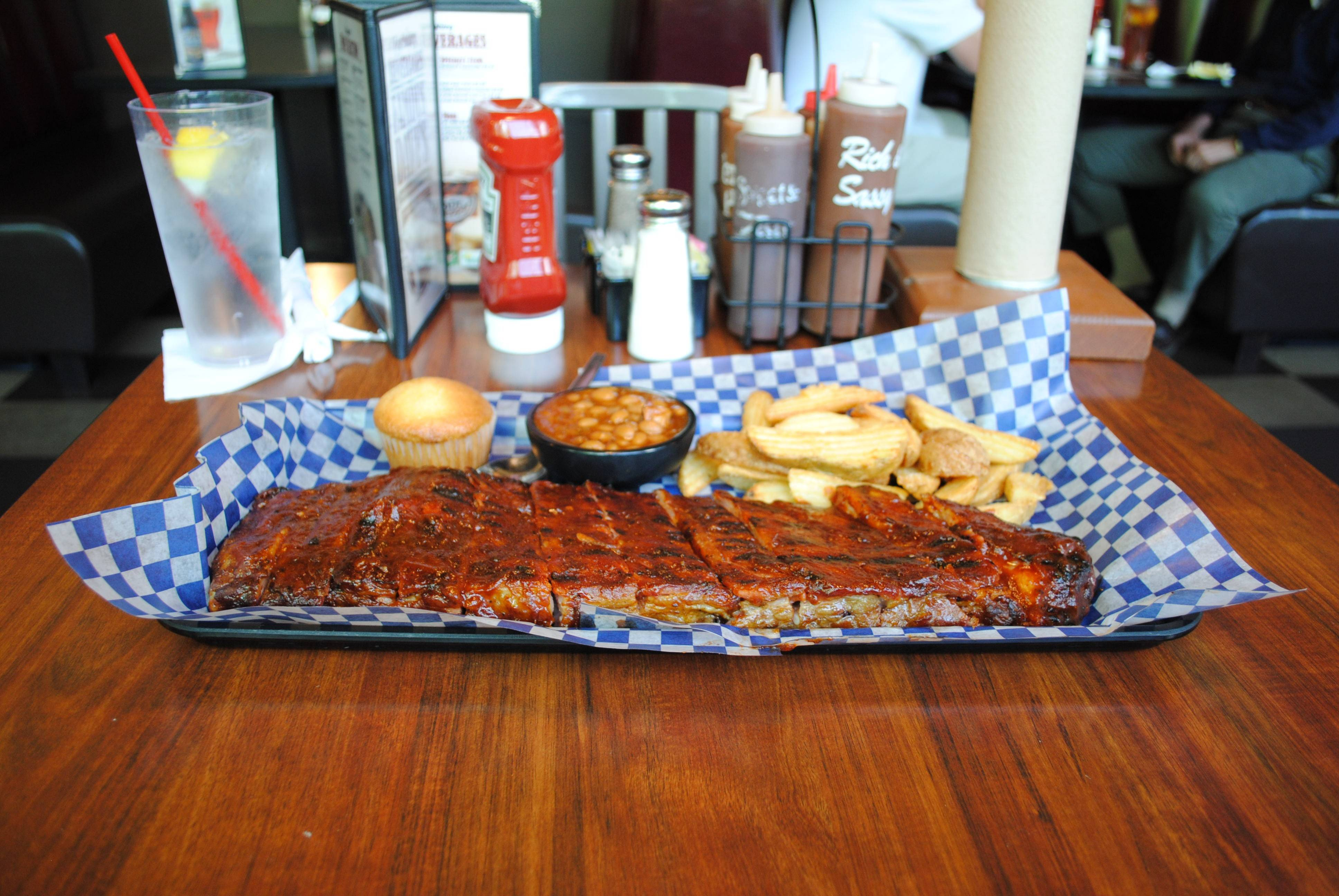 "Famous Dave's ""The Big Slab"" of St. Louis-style pork spareribs with fries, Wilbur beans and a cornbread muffin has 2,770 calories."