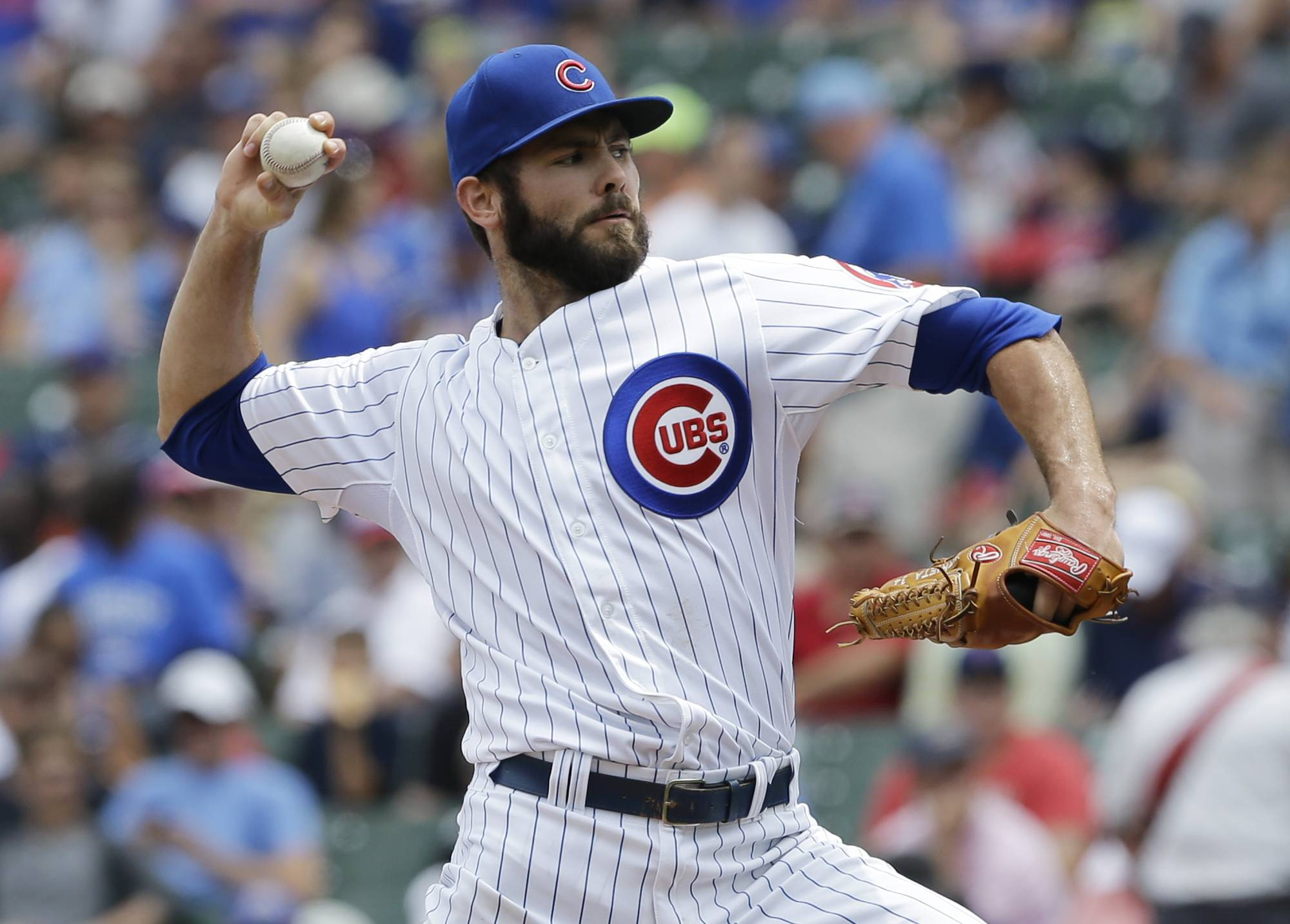 Chicago Cubs starter Jake Arrieta throws against the Colorado Rockies during the first inning of a baseball game in Chicago, Thursday, July 31, 2014.