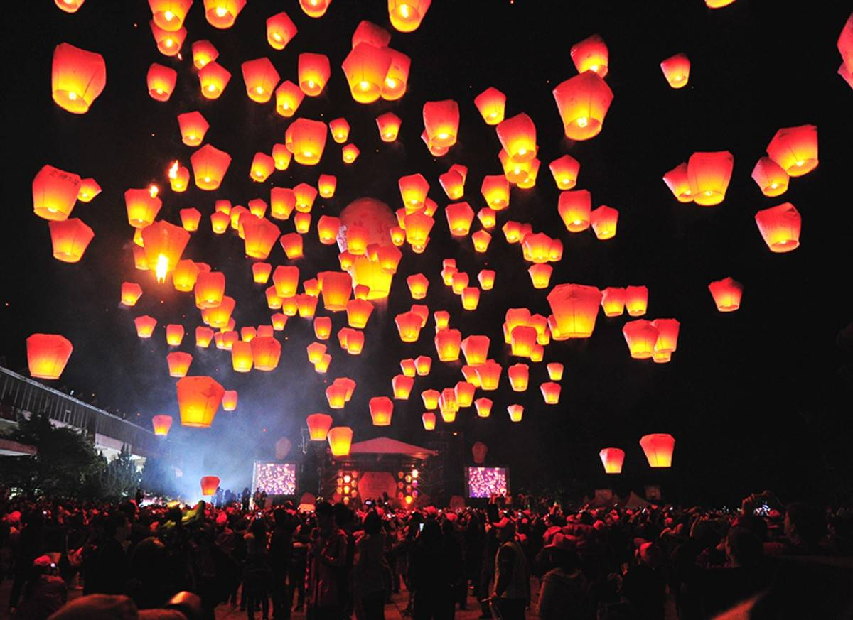 "Chang Hsiu-huang took this photo of the release of lanterns containing people's wishes and hopes, a tradition during the Lantern Festival. The photo, part of the ""Light and Shadow"" exhibit, will be on display through Aug. 30  in Bartlett."