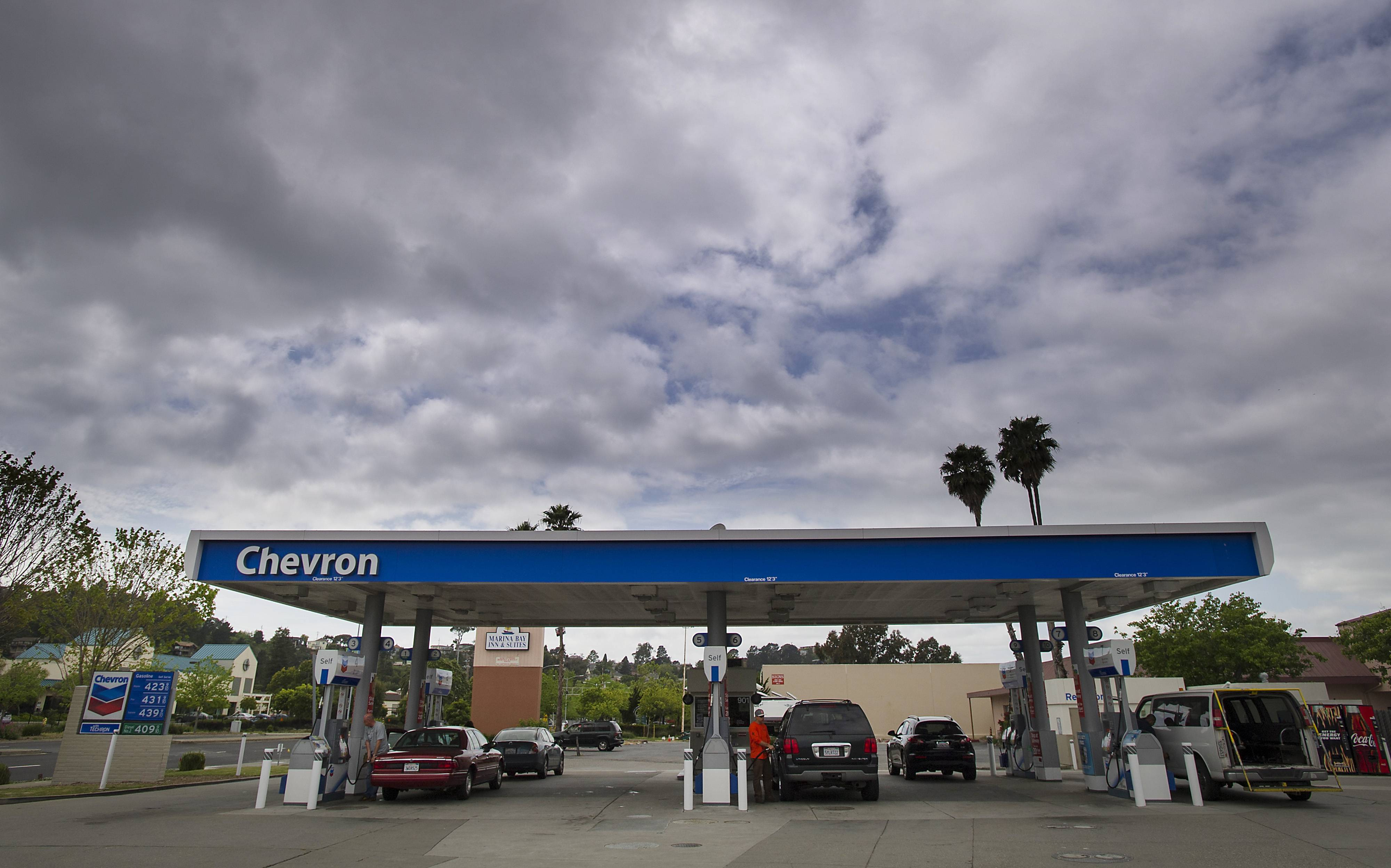 Chevron Corp. earnings rose 5.6 percent in the second quarter on asset sales and higher global oil prices, though oil and gas production slipped slightly.