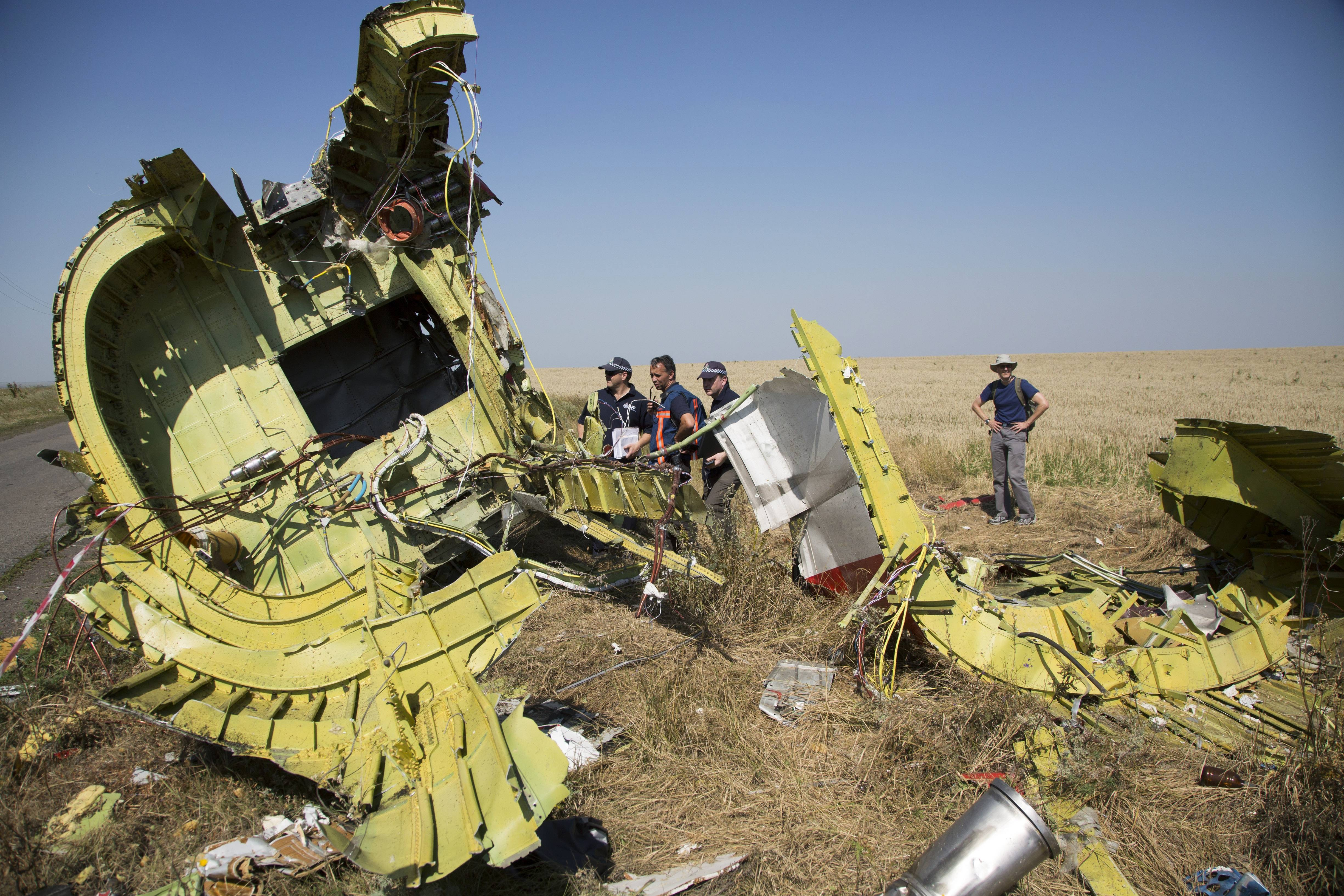 Australian and Dutch investigators examine pieces of the Malaysia Airlines Flight 17 plane, near the village of Hrabove, Donetsk region, eastern Ukraine Friday, Aug. 1, 2014.