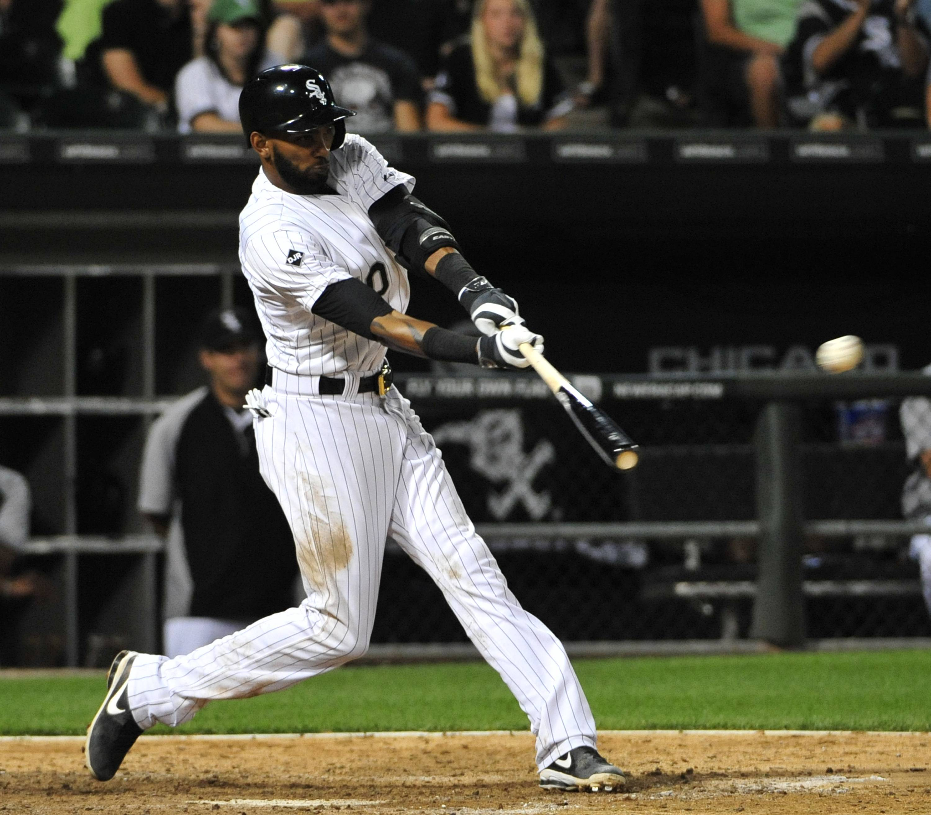 The White Sox's Alexei Ramirez hits an RBI double against the Minnesota Twin during the sixth inning of a baseball game, Friday, Aug. 1, 2014, in Chicago. (AP Photo/David Banks)