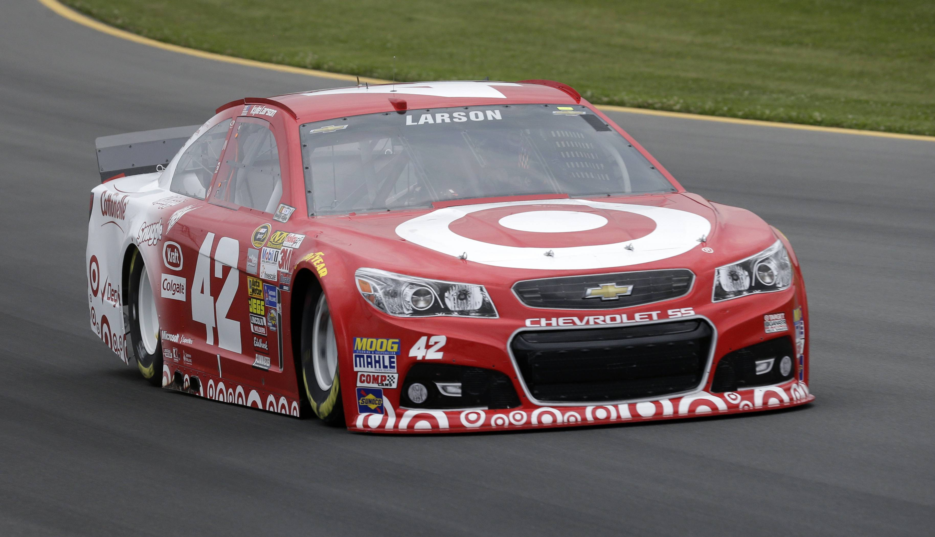 Kyle Larson drives during qualifying for Sunday's NASCAR Sprint Cup Series auto race at Pocono Raceway, Friday, Aug. 1, 2014, Long Pond, Pa. Larson qualified on the pole.