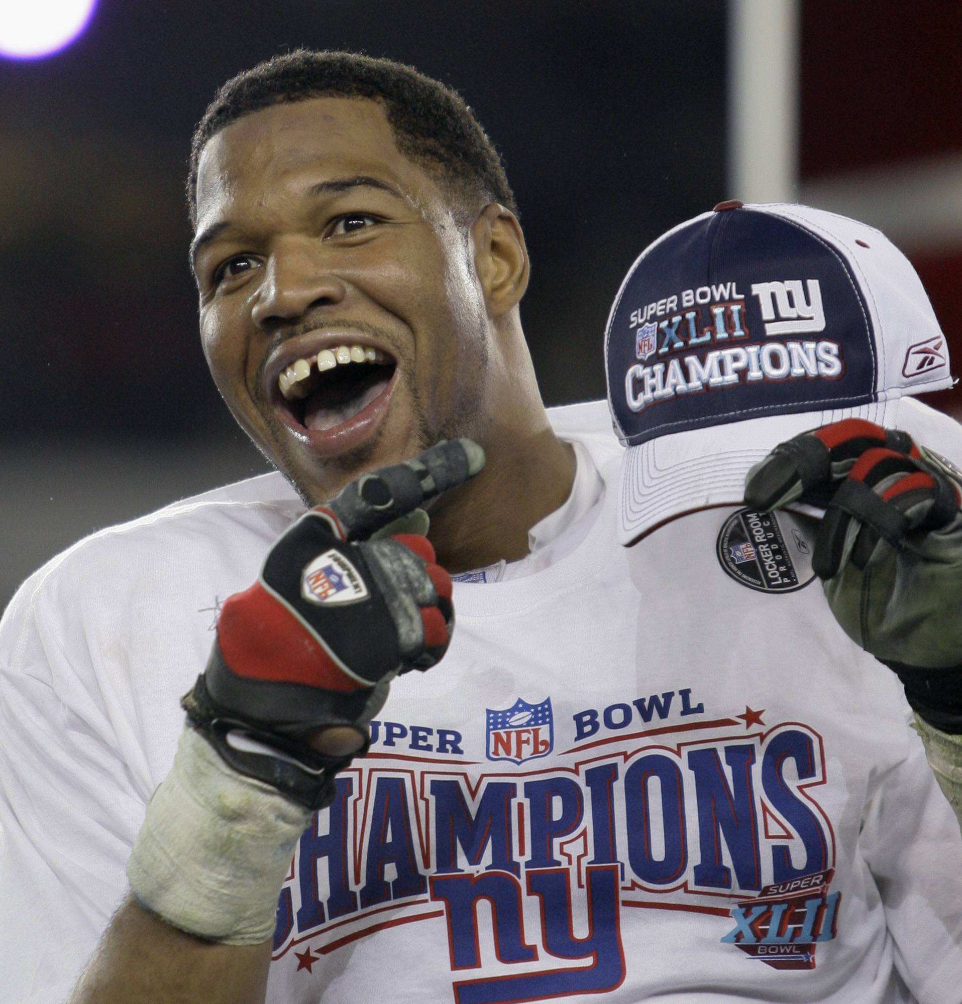 Former New York Giants defensive end Michael Strahan, shown here in 2008, was a game-changer on the field — but he made his mark elsewhere with his gregarious personality, gaptoothed smile and willingness to step out of his comfort zone. He became a regular in commercials.