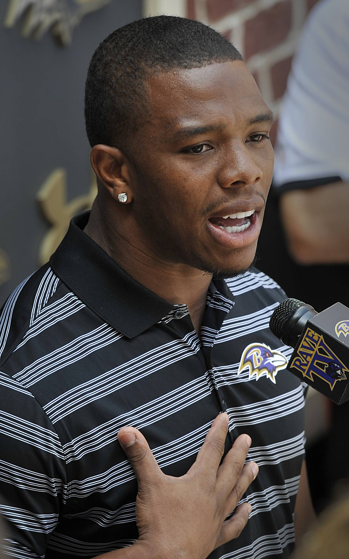Baltimore Ravens running back Ray Rice answers question during a news conference after NFL football training camp, Thursday, July 31, 2014, in Owings Mills, Md.