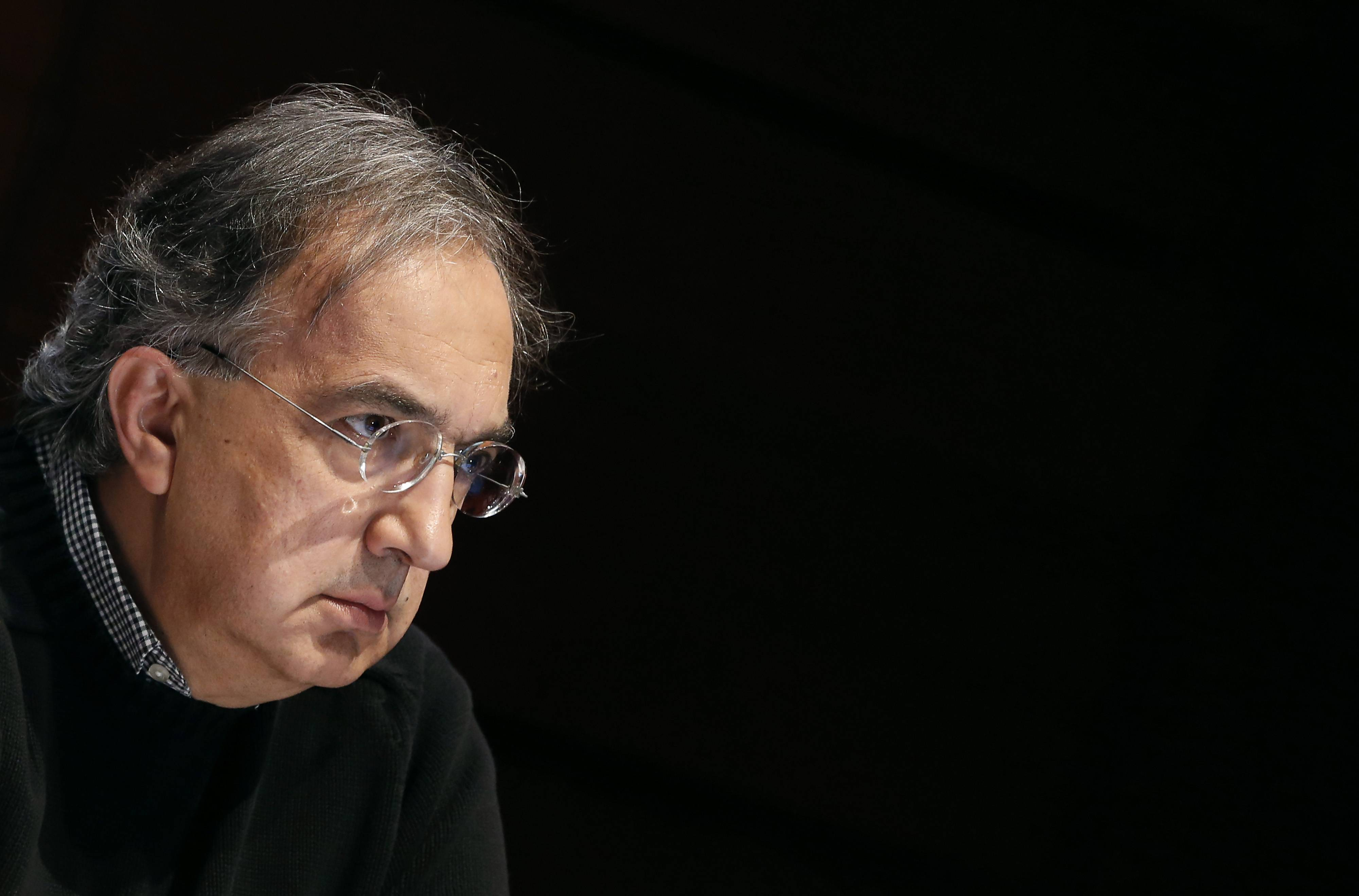 Sergio Marchionne, chief executive officer of Fiat SpA and Chrysler Group LLC, pauses during the company's annual general meeting in Turin, Italy. Fiat shareholders have voted in favor of a merger with Chrysler that has been five years in the works and will shift the 115-year-old carmaker's center of gravity abroad.