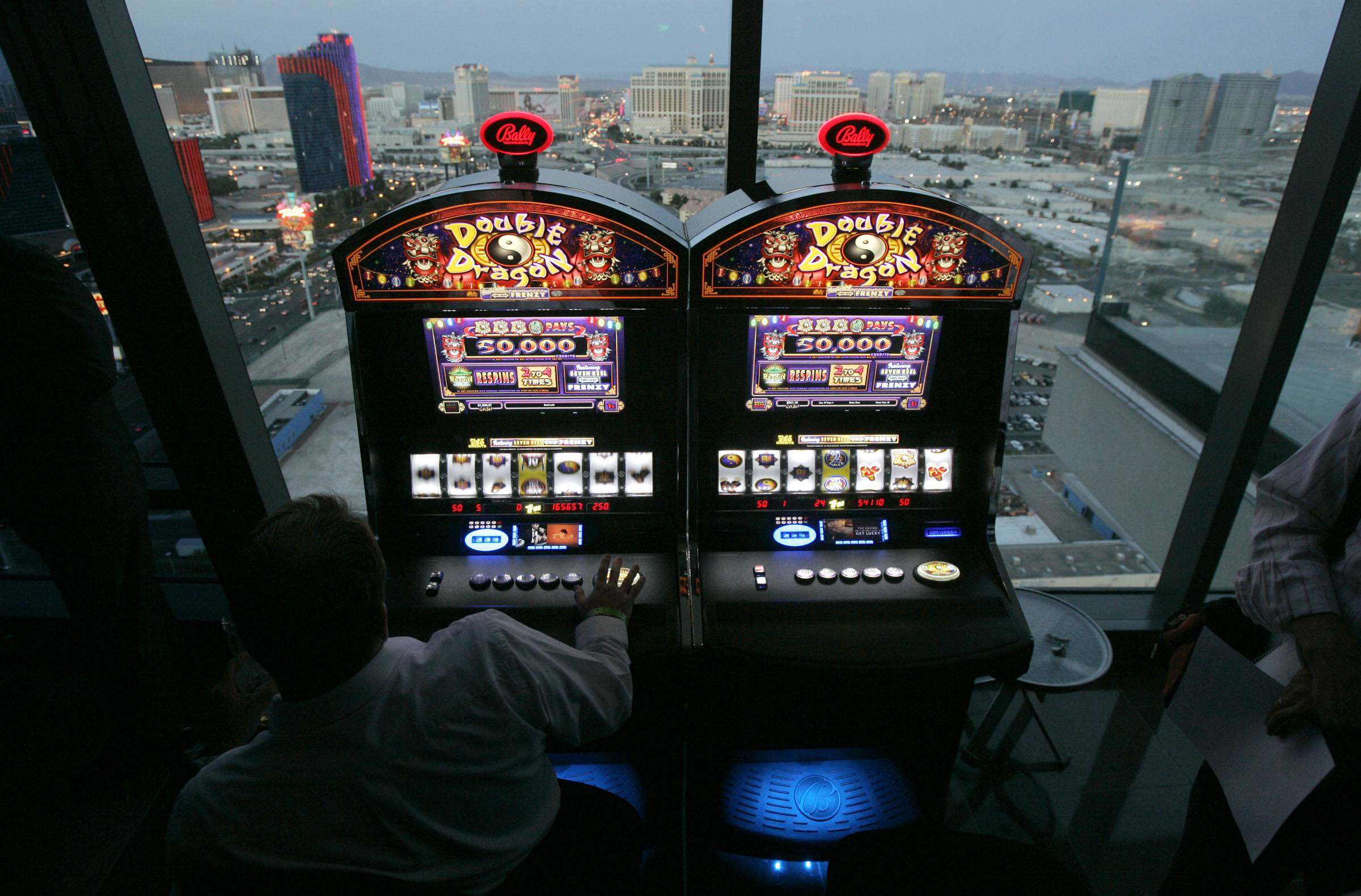 Scientific Games on Friday, Aug. 1, 2014 said it will pay about $3.3 billion to buy slot machine maker Bally Technologies in a cash deal that expands its casino management system portfolio.