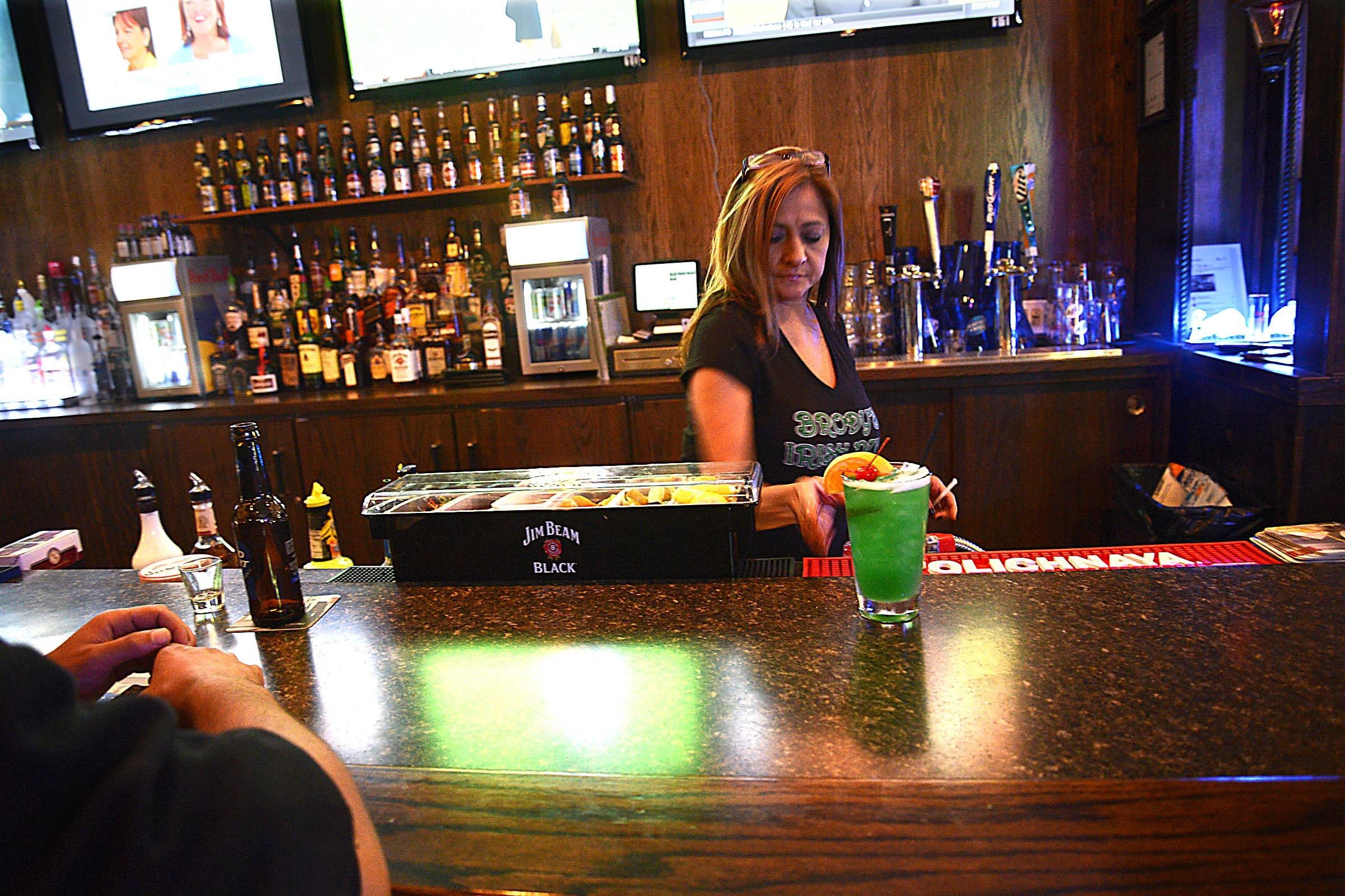 Bartender Denise Clark serves drinks at Brody's Irish Pub in Aurora.